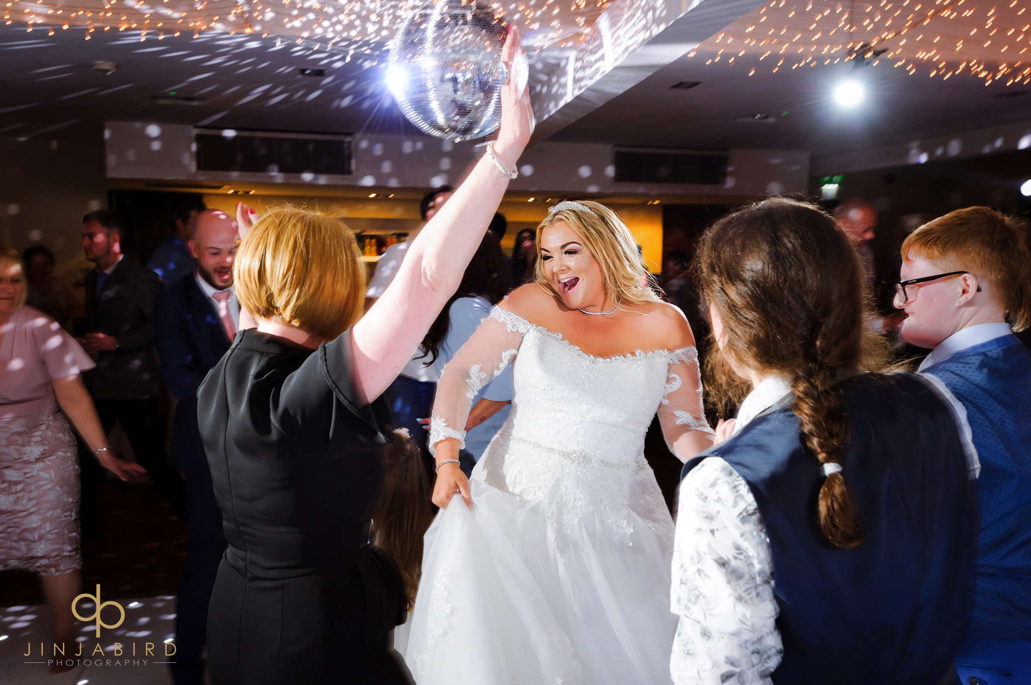 bride dancing with mum