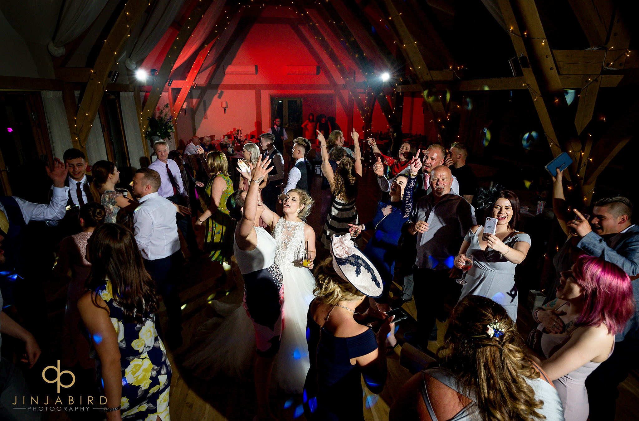 bride dancing with arms in air