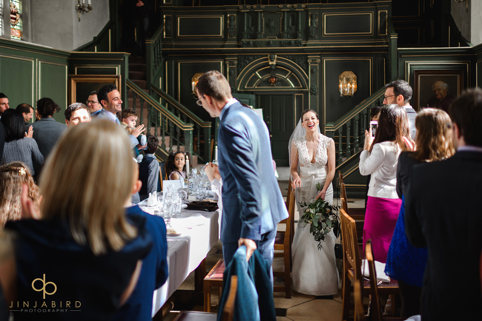 bride entering wedding breakfast magdalene college cambridge