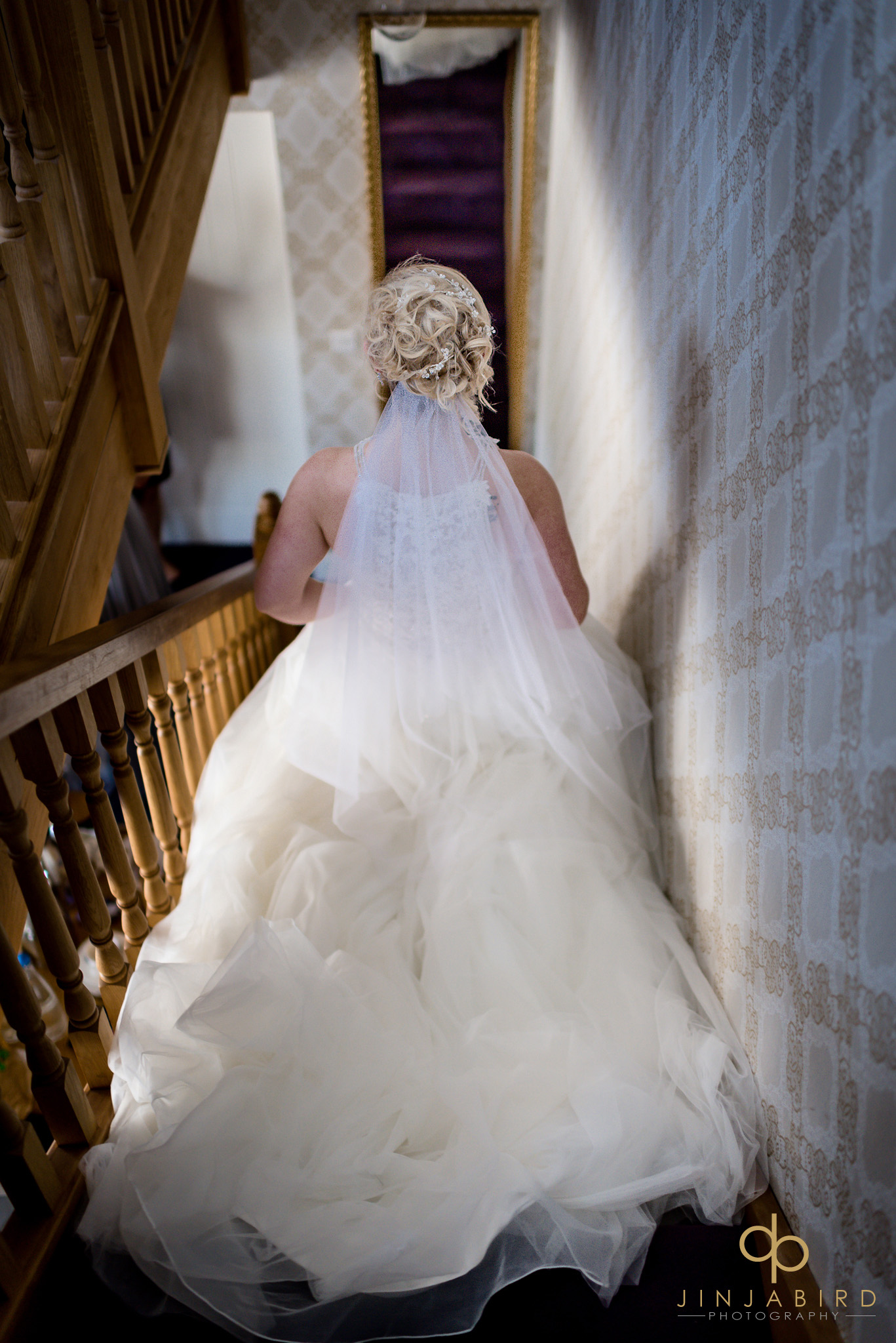 bride going down stairs bassmead manor