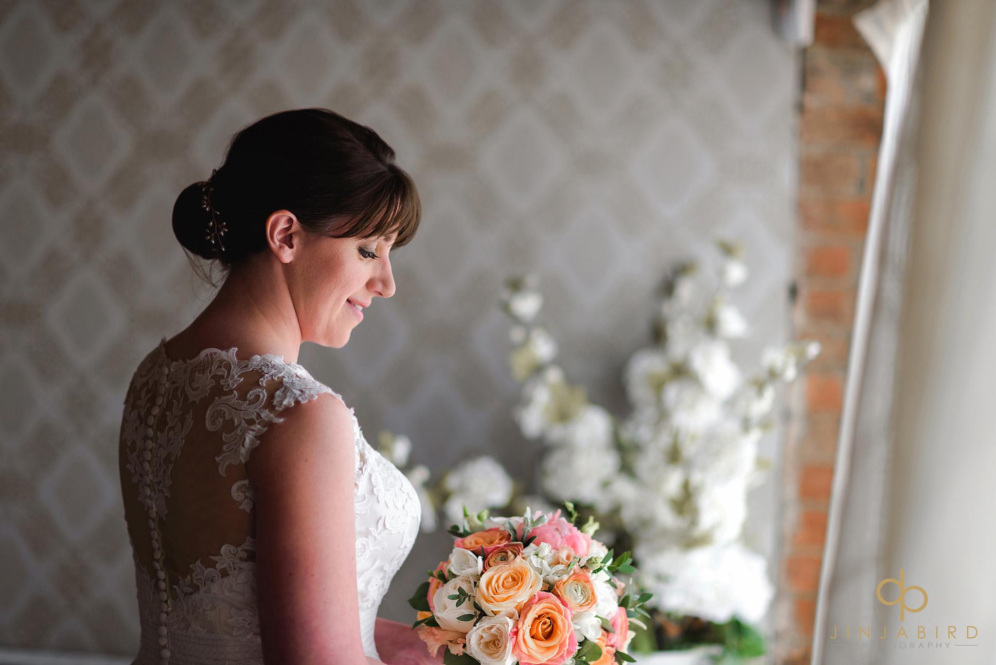 bride holding bouquet bassmead