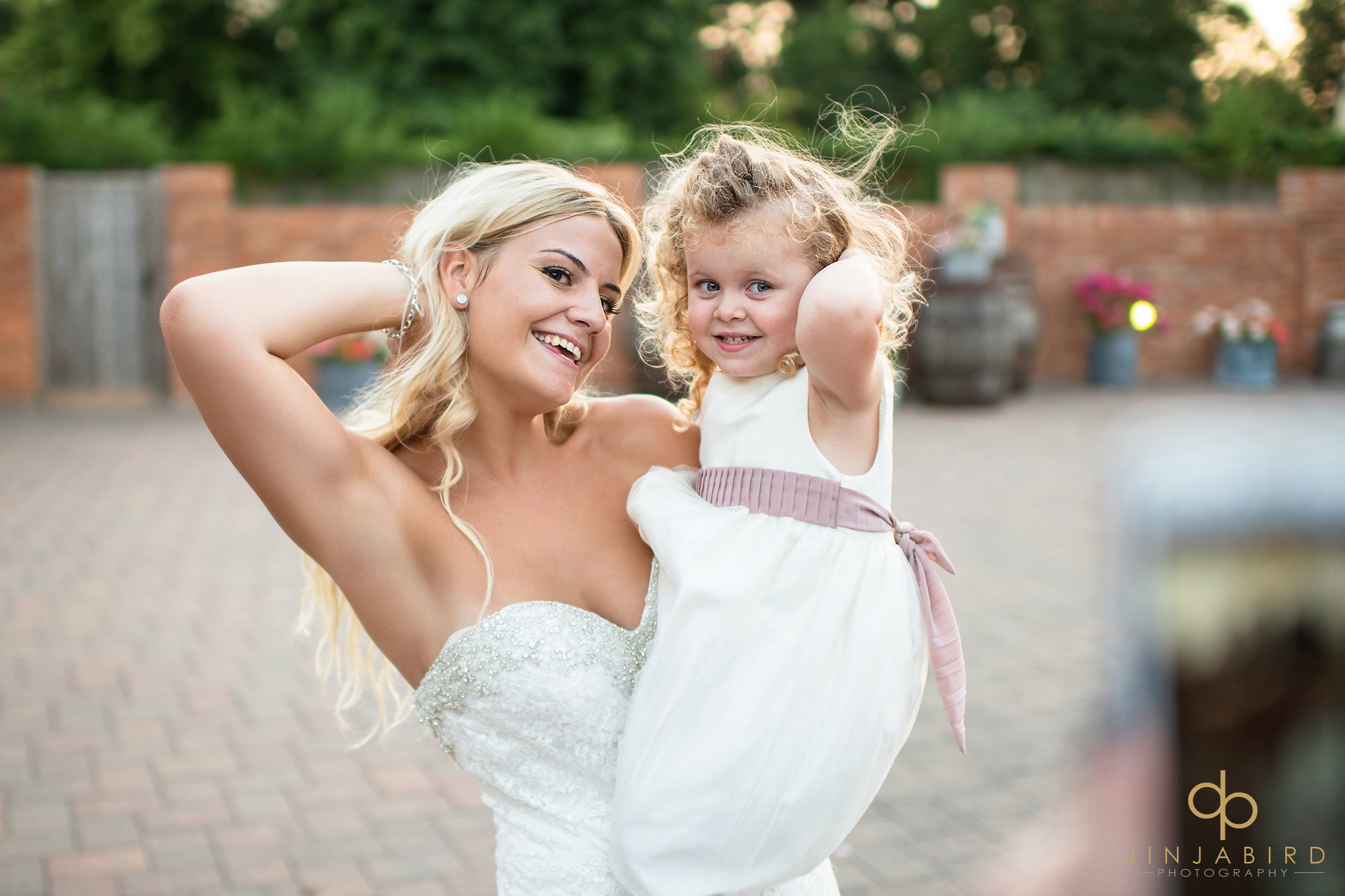 bride holding bridesmaid