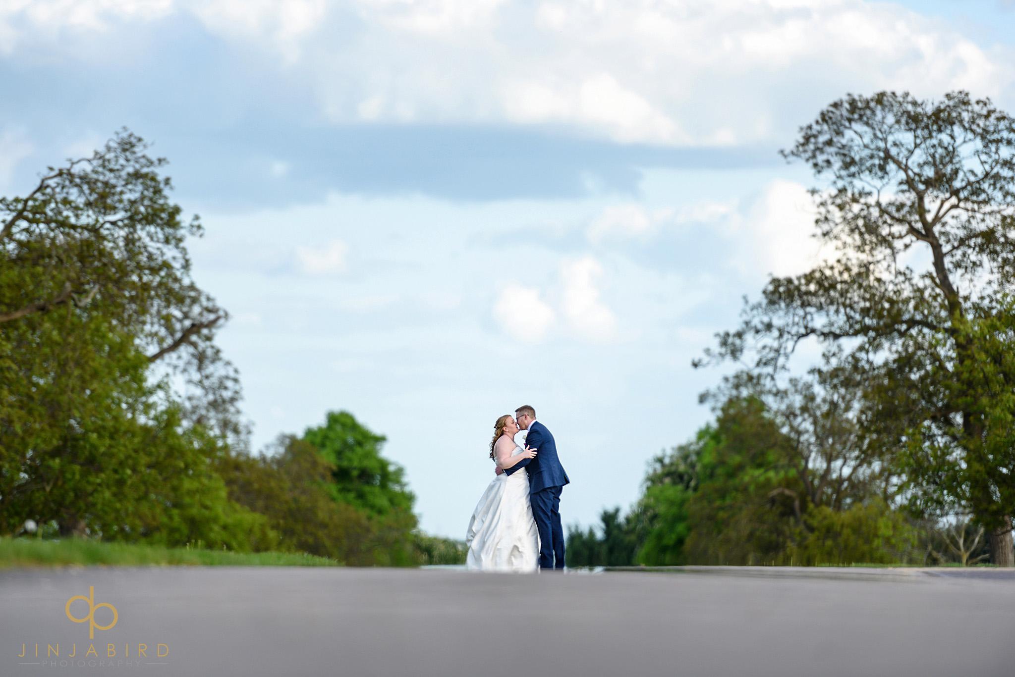 bride kissing groom bassmead manor drive