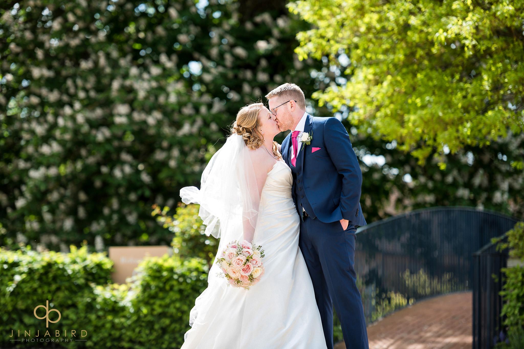 bride kissing groom bassmead manor