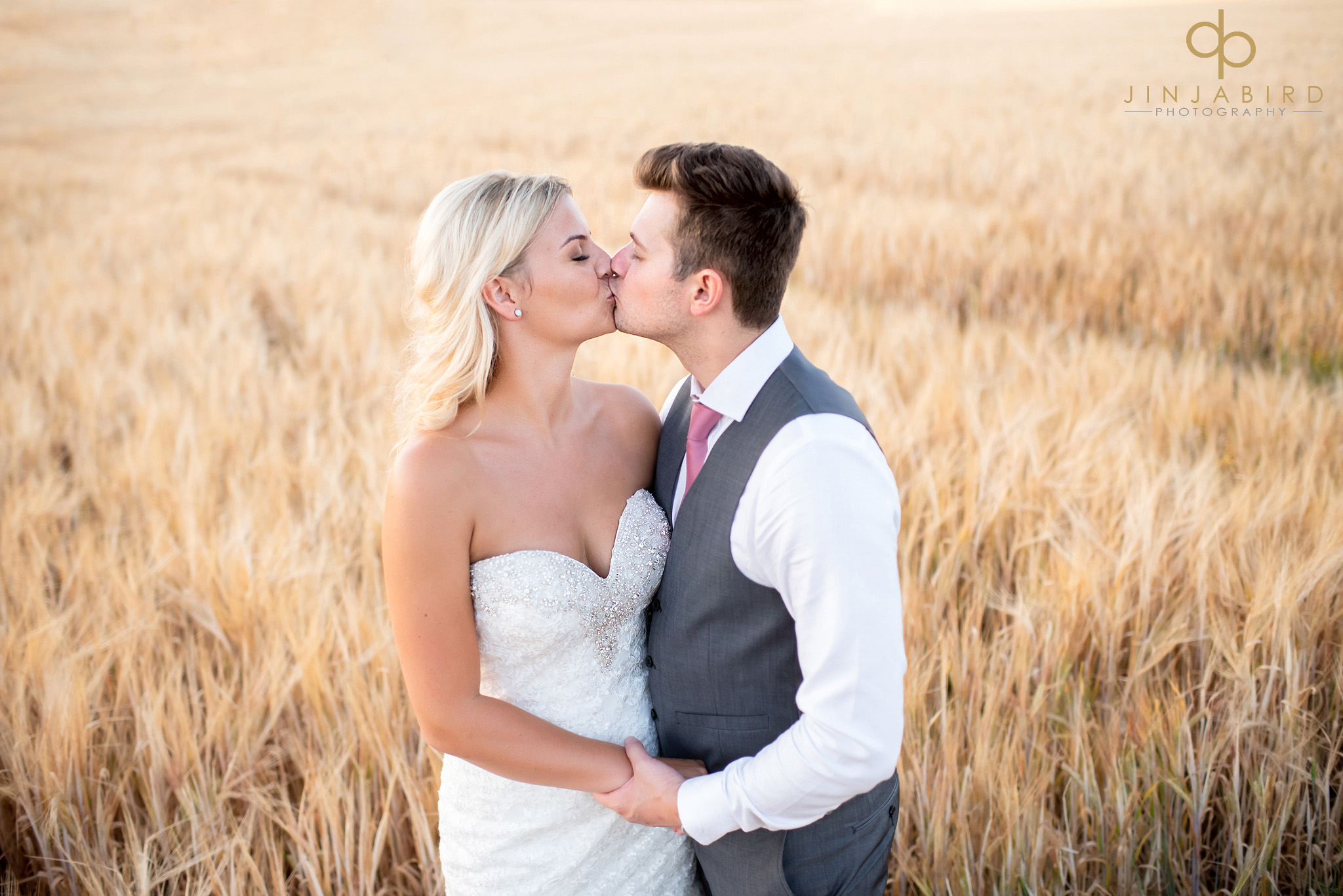 bride kissing groom cornfield bassmead manor