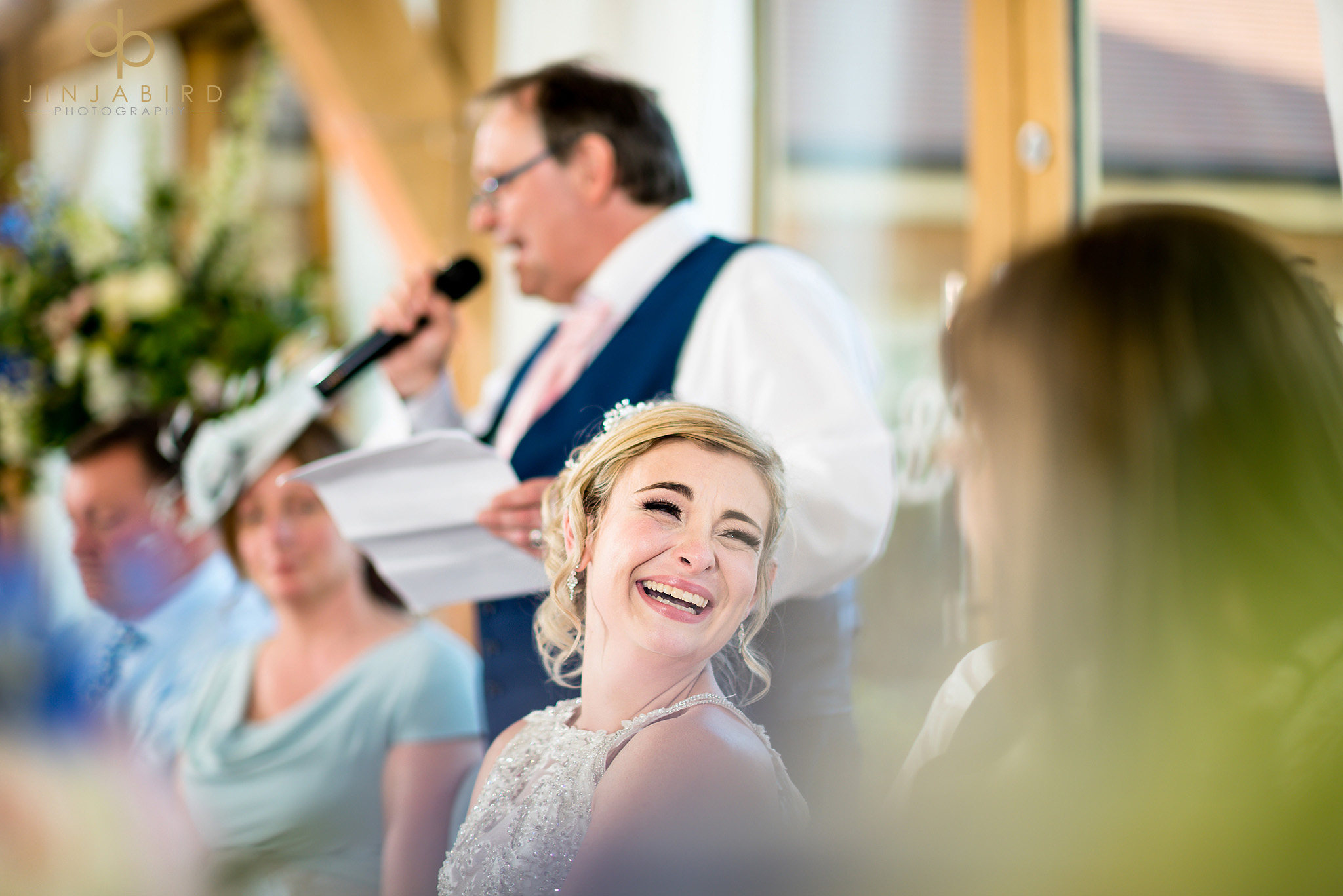 bride laughing during speech bassmead manor