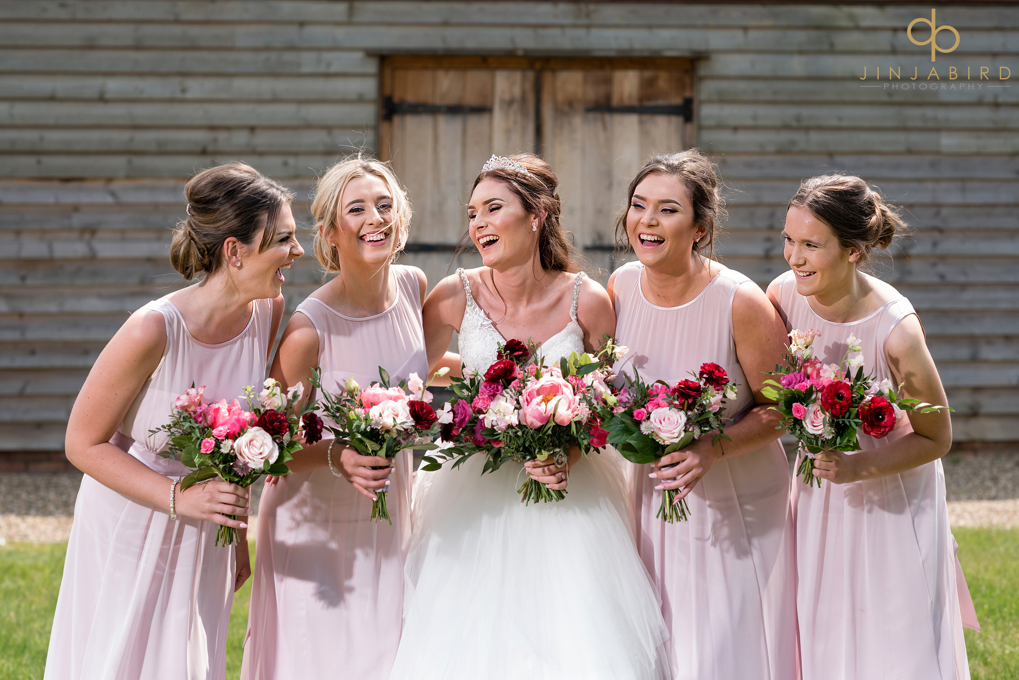 bride laughing with bridemaids
