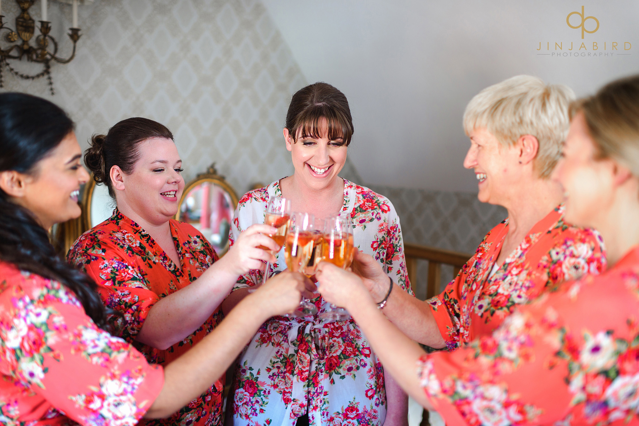bride with bridesmaid champagne toast