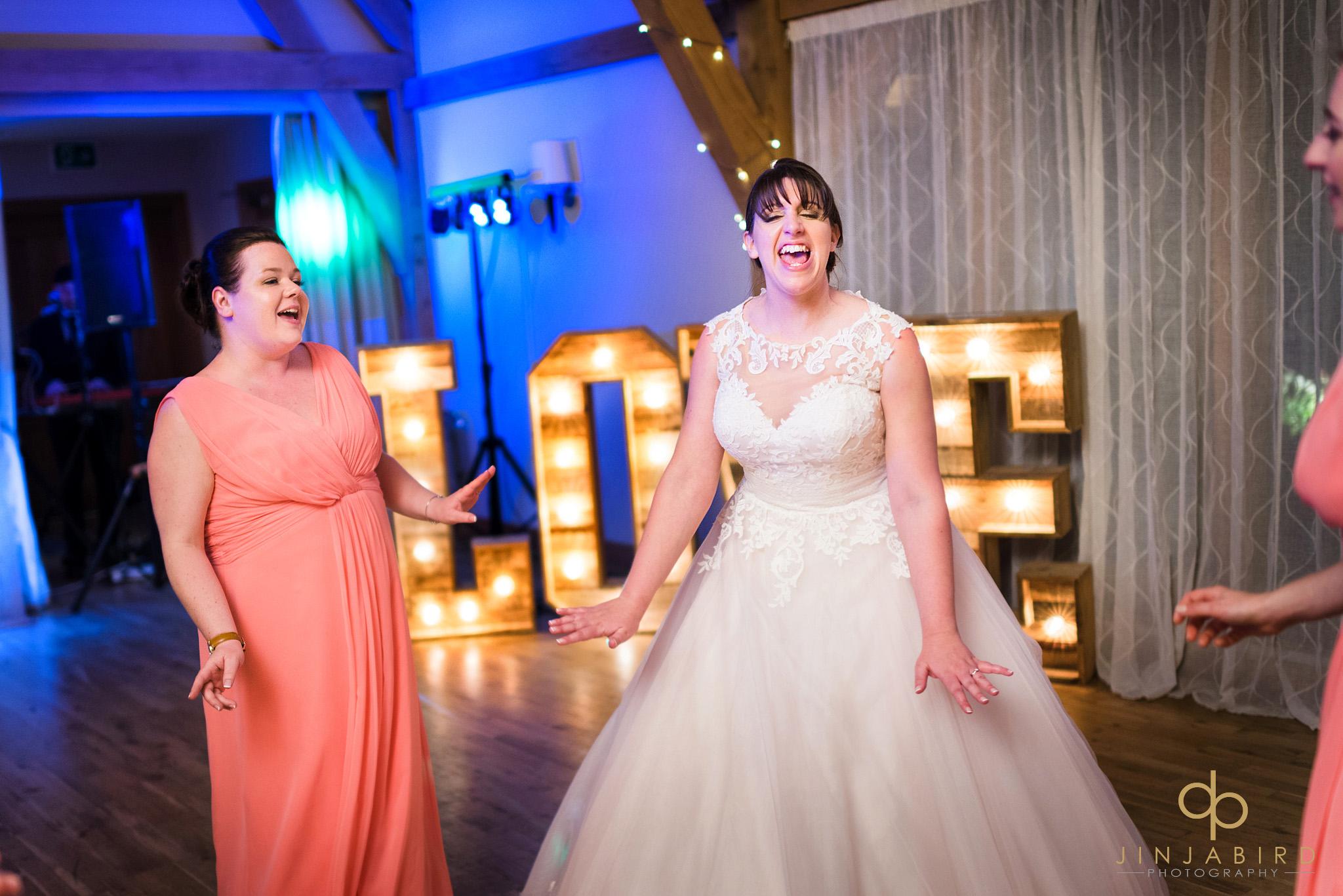 bride with bridesmaid dancing