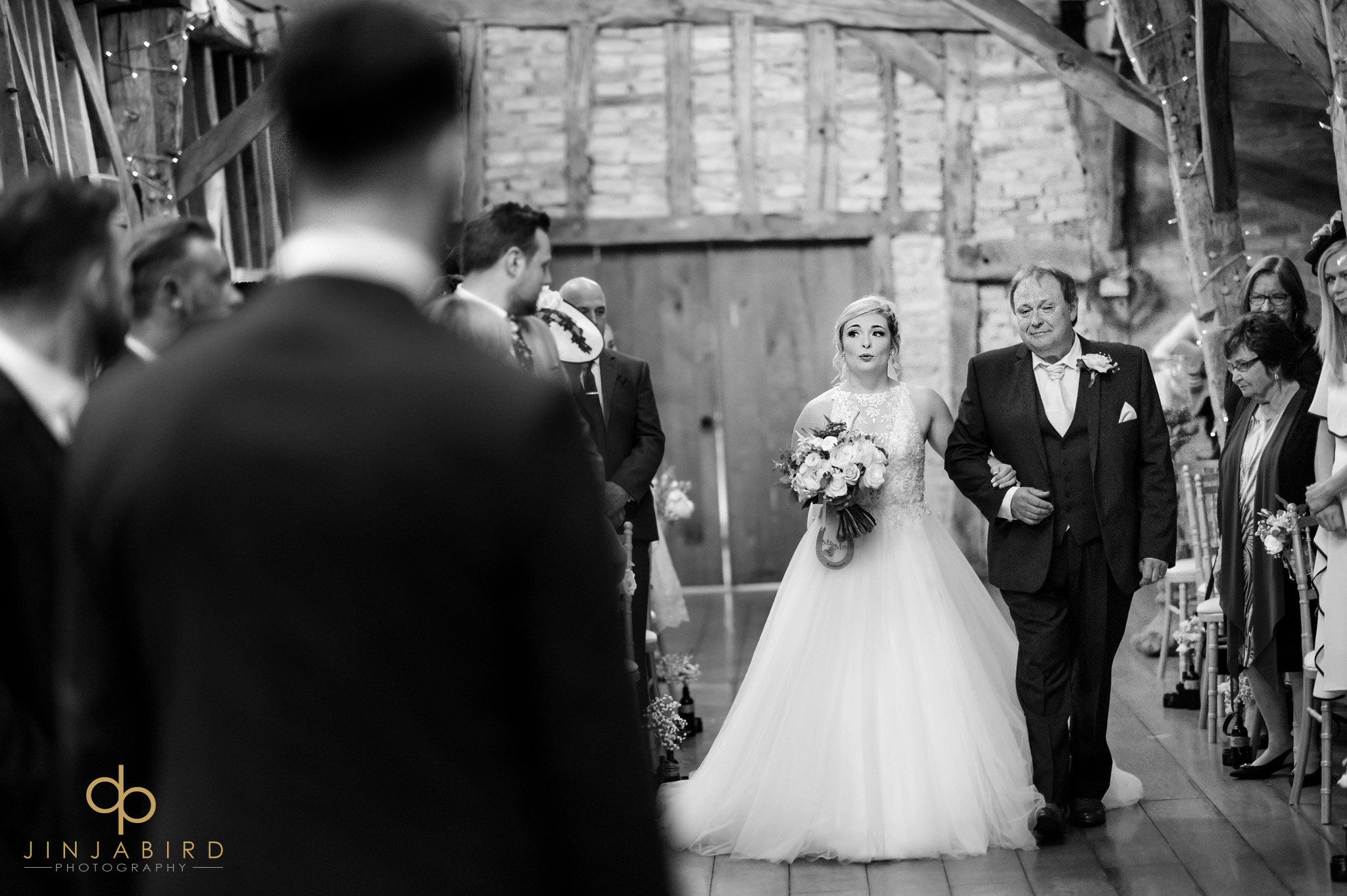 bride with father rickety barn