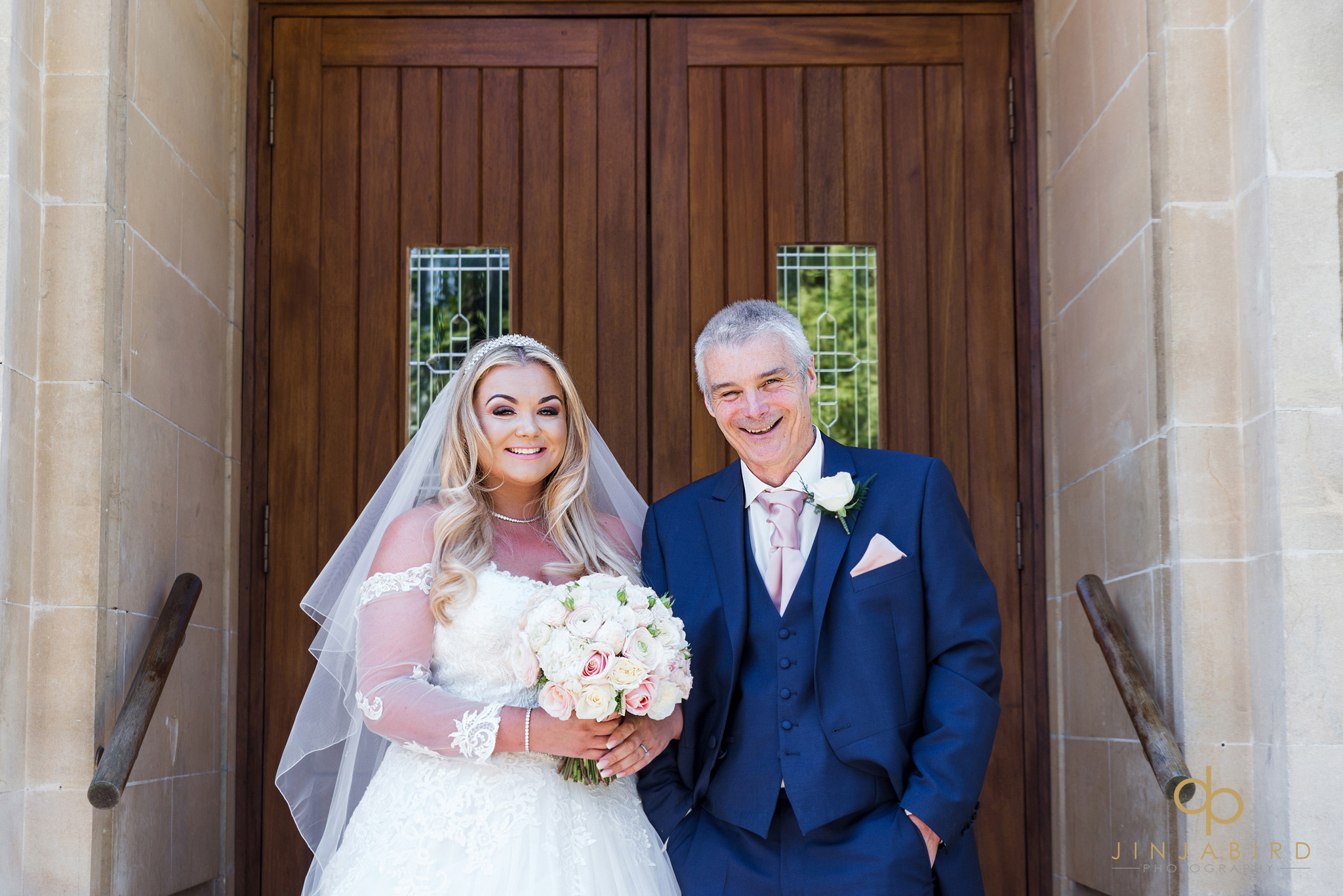 bride with father st-josephs church gerrards cross