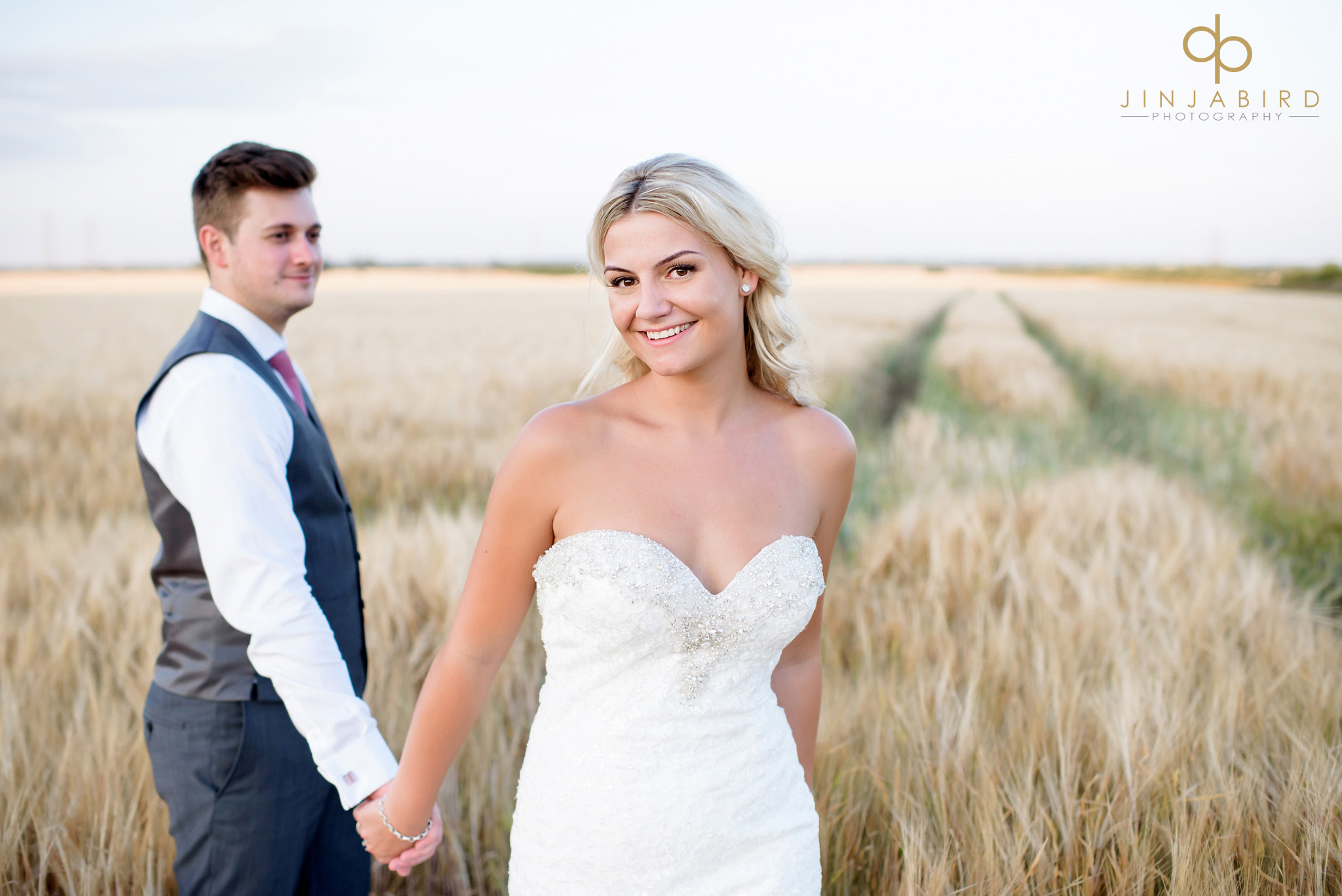 bride with groom in cornfield bassmead manor