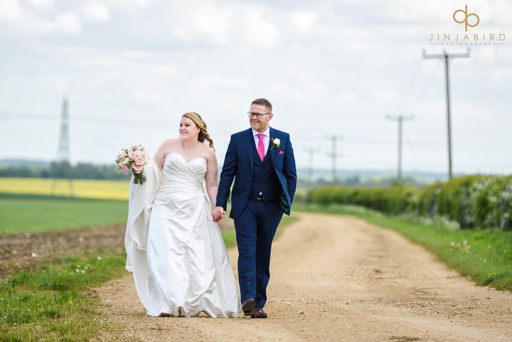 bride with groom in field bassmead manor