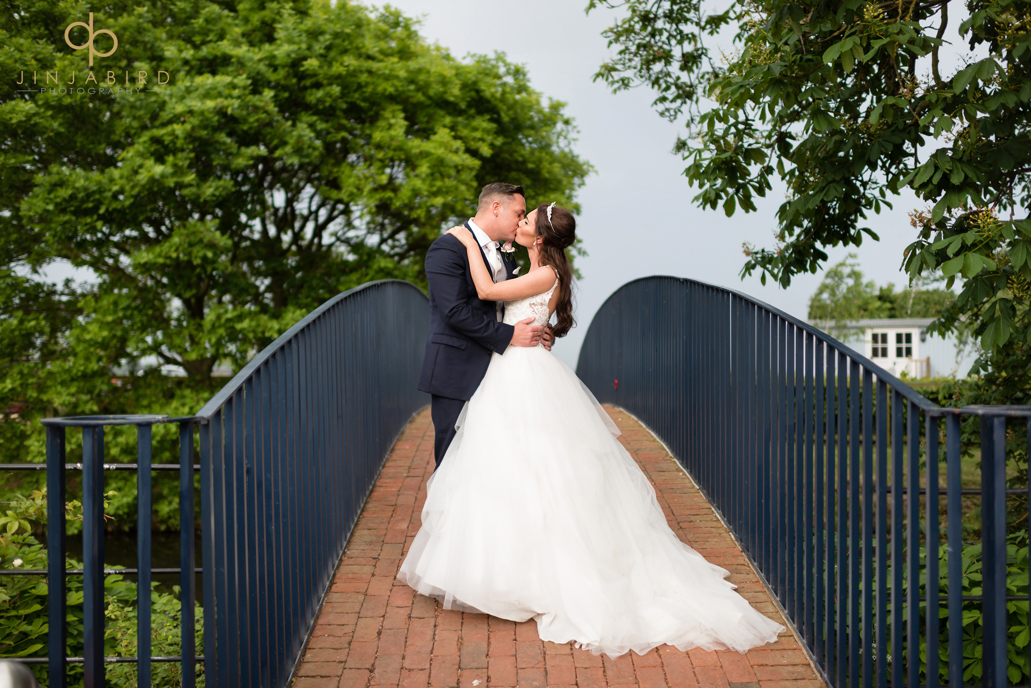 bride with groom on bridge bassmead manor
