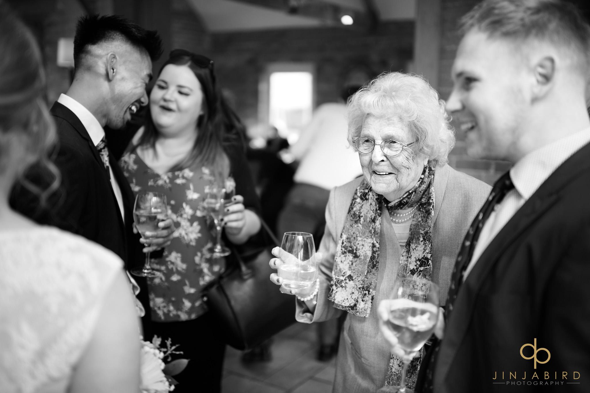 brides grandmother having drink