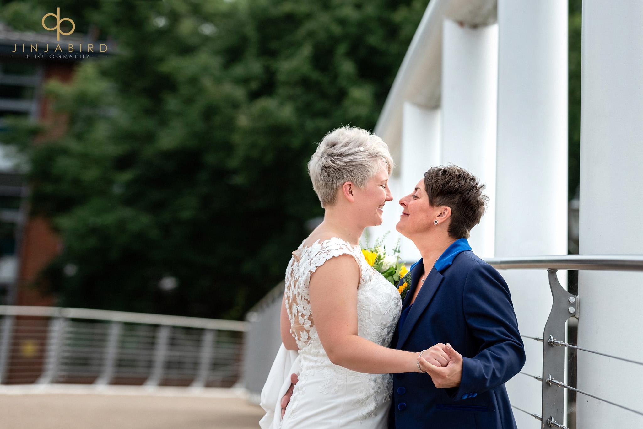 brides hugging on bedford bridge
