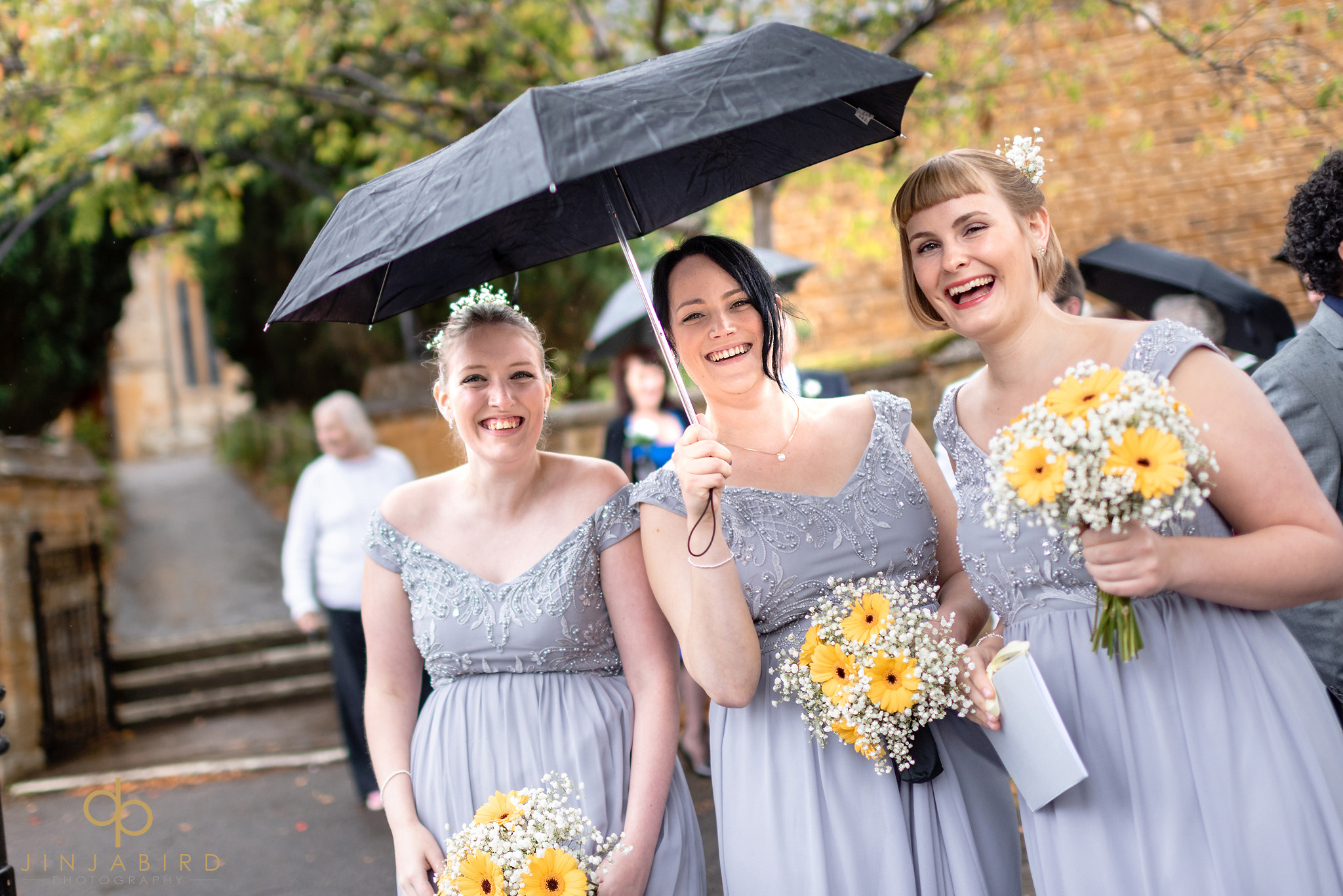 brides-maids under umbrella