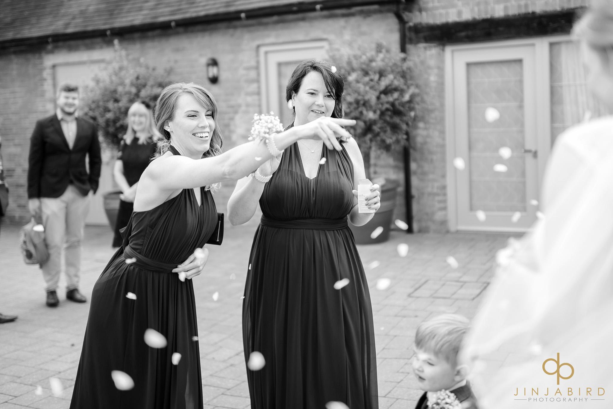 bridesmaids with confetti