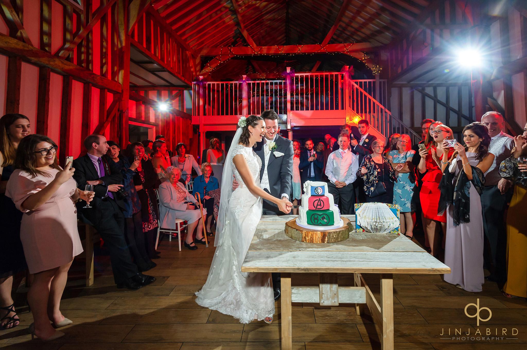 cutting wedding cake milling barn