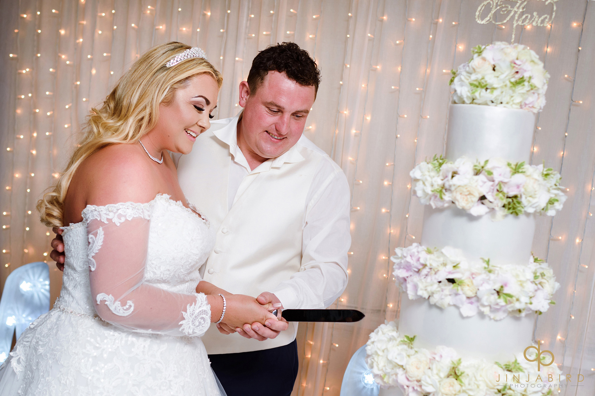 cutting-wedding-cake-stoke-place
