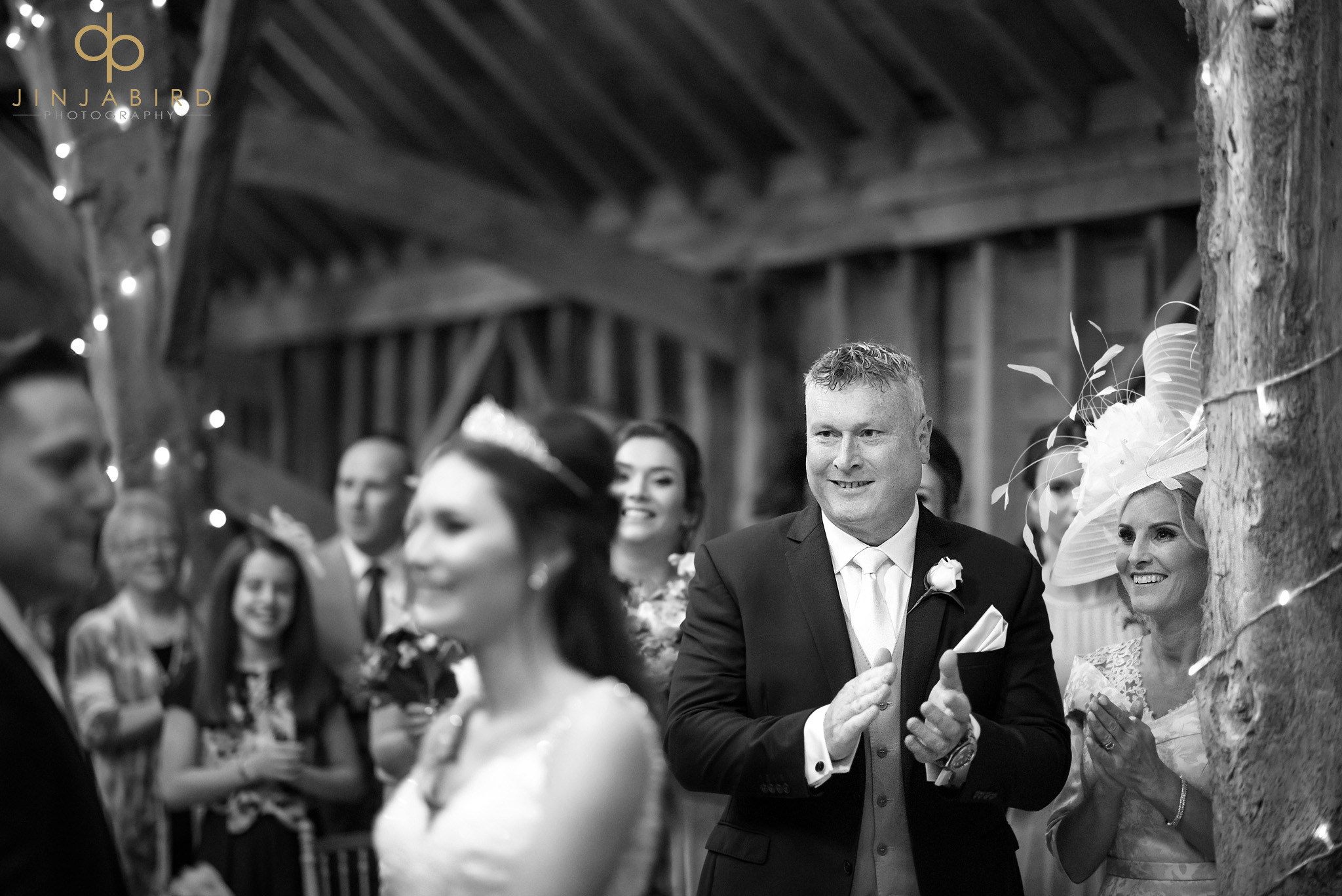 father clapping wedding ceremony
