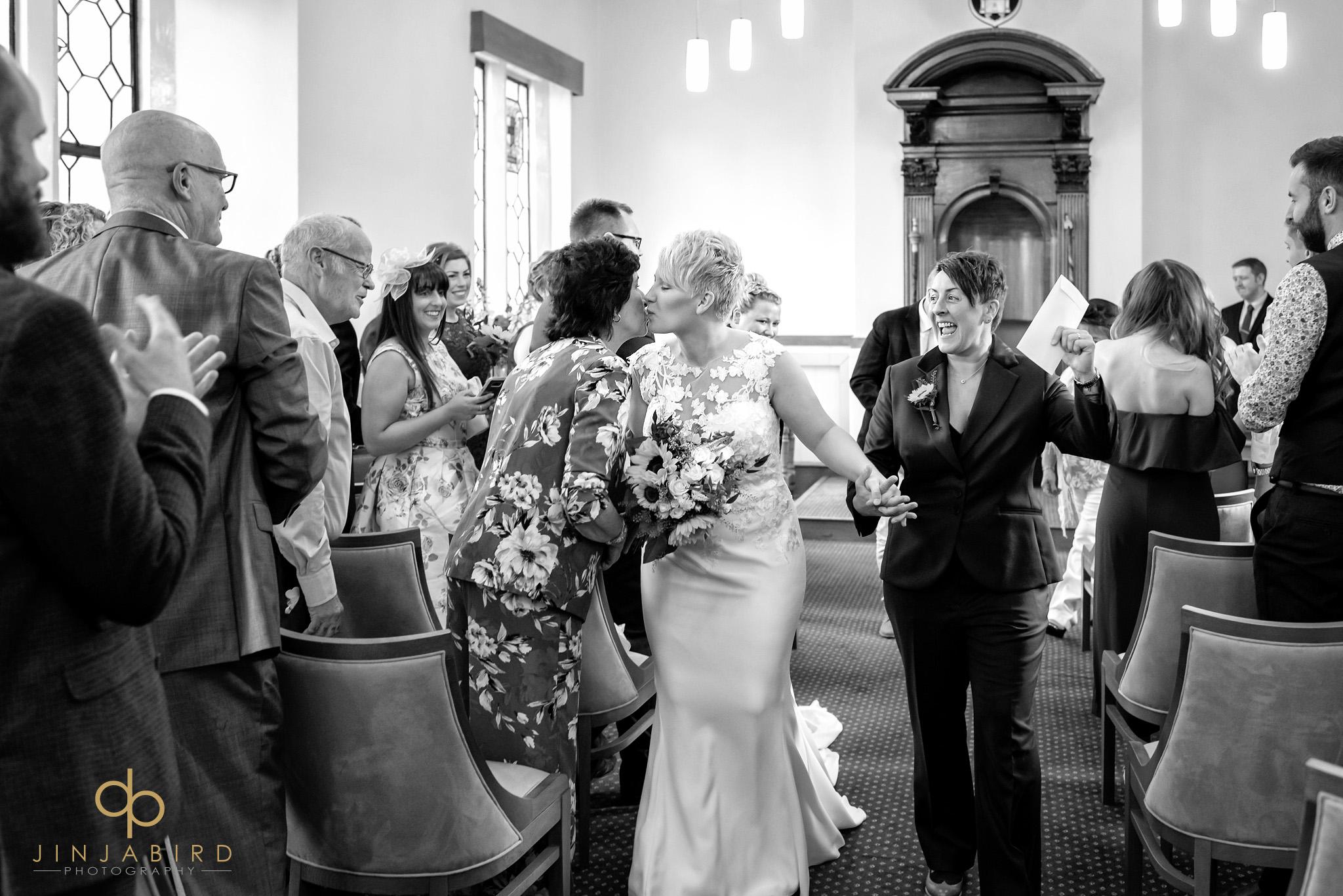 gay brides coming down aisle