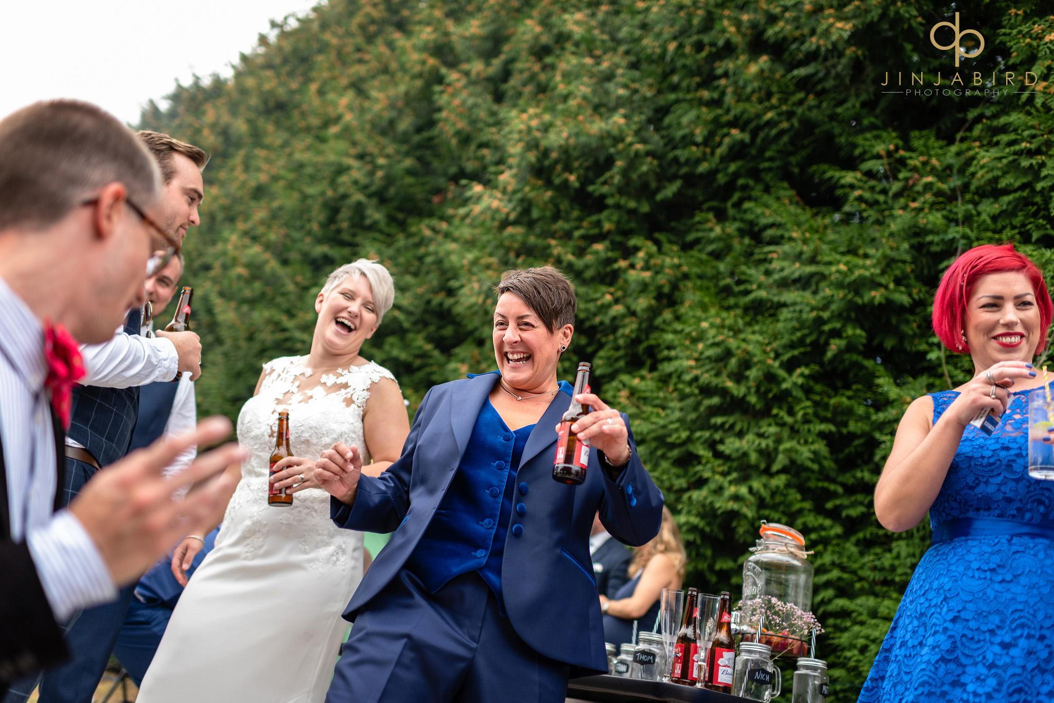 gay brides laughing
