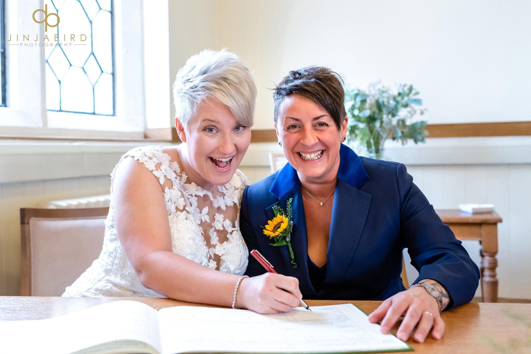 gay brides signing register bedford