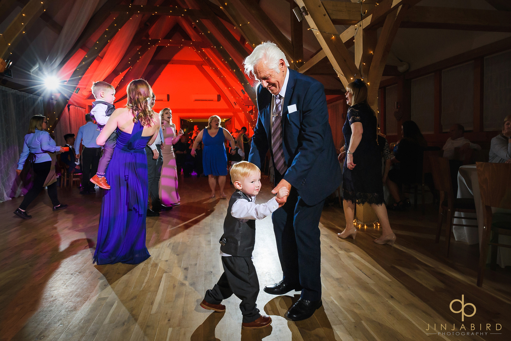 grandfather dancing with pageboy