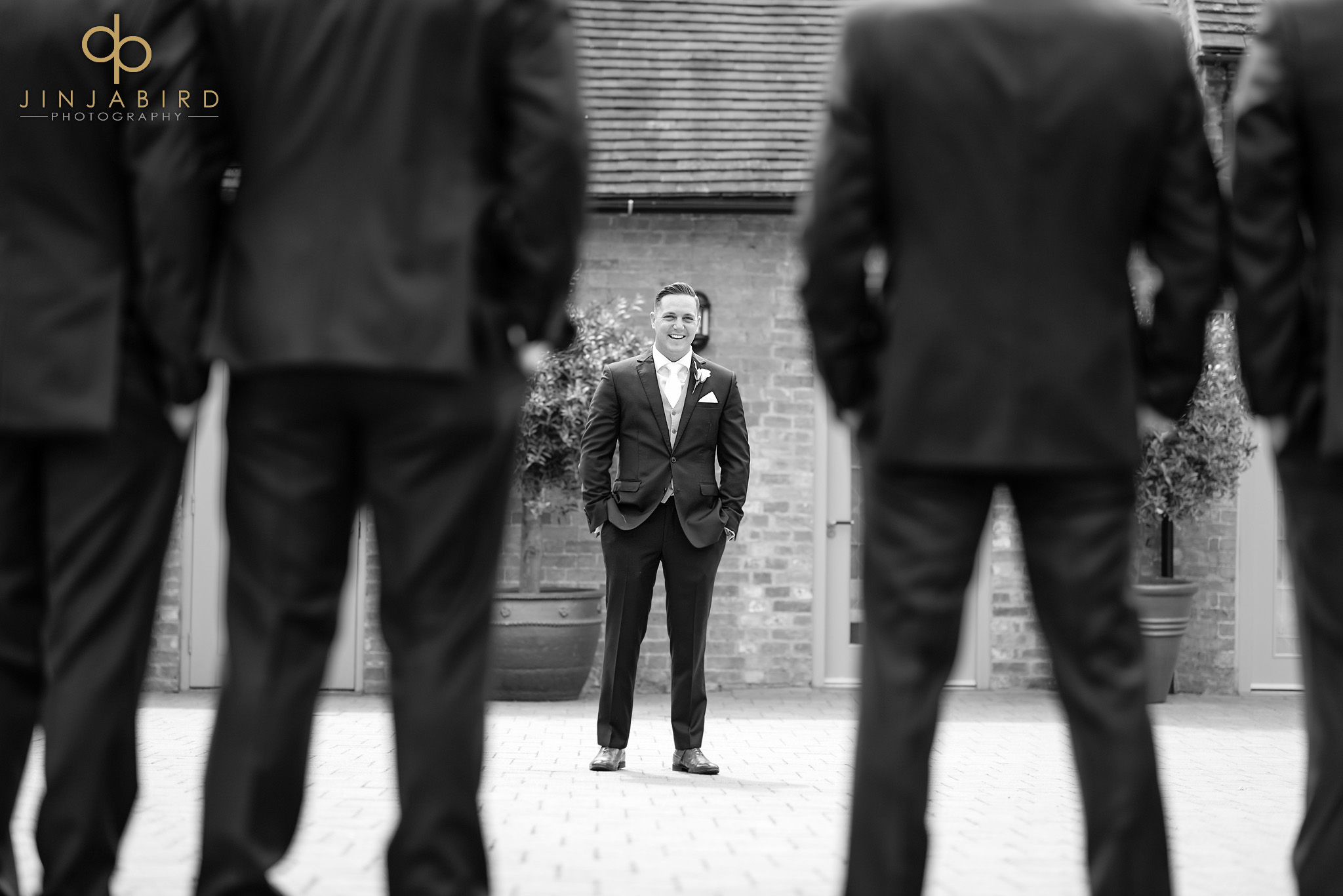groom looking at ushers