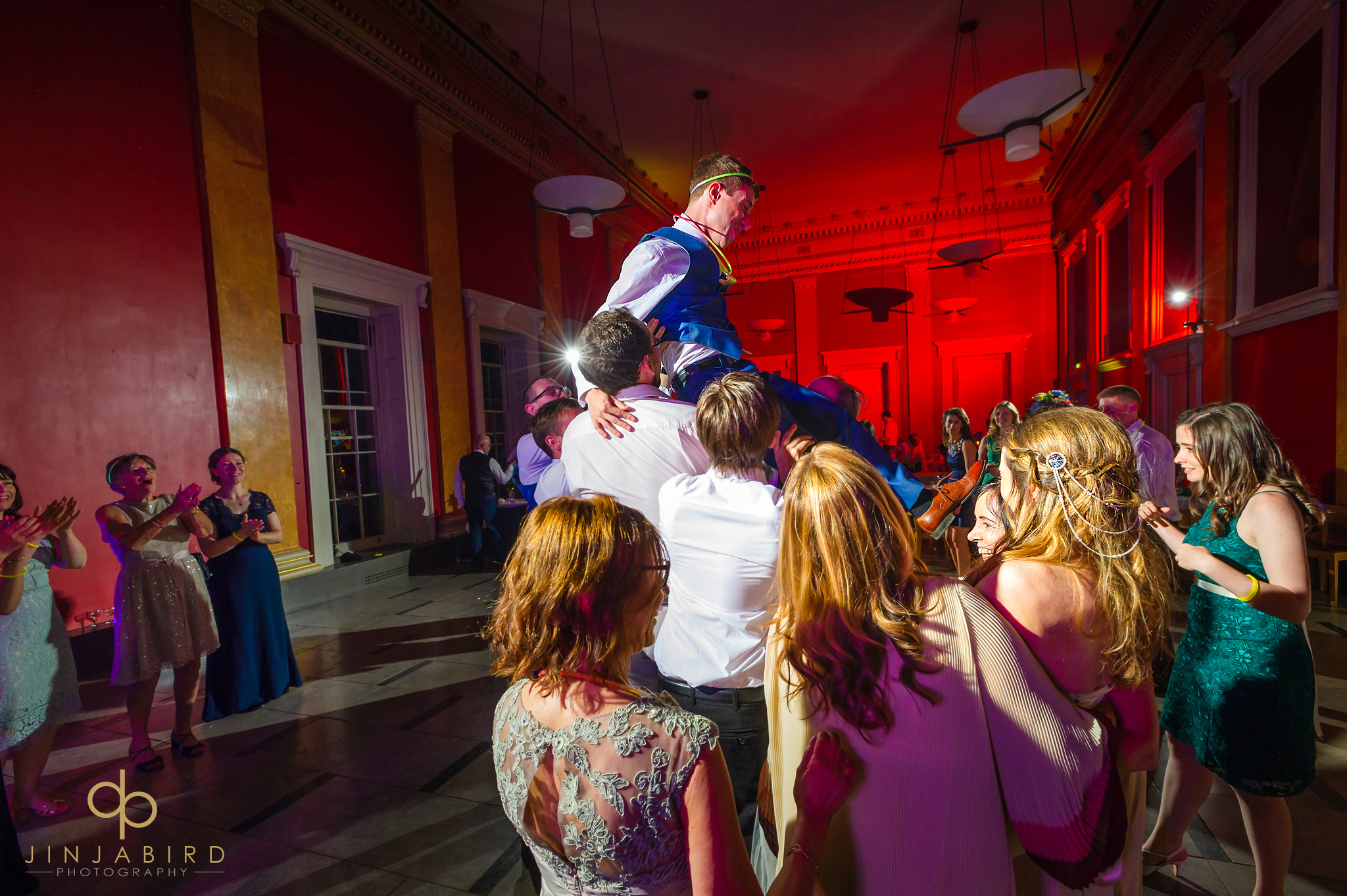 groom on shoulders downing college