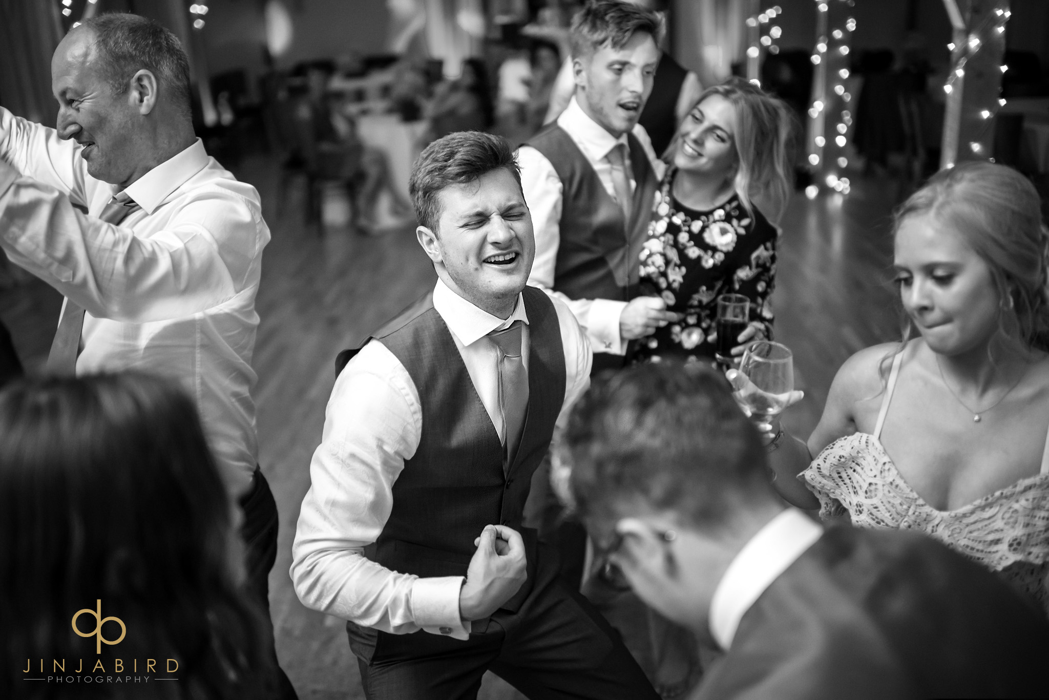 groom playing air guitar