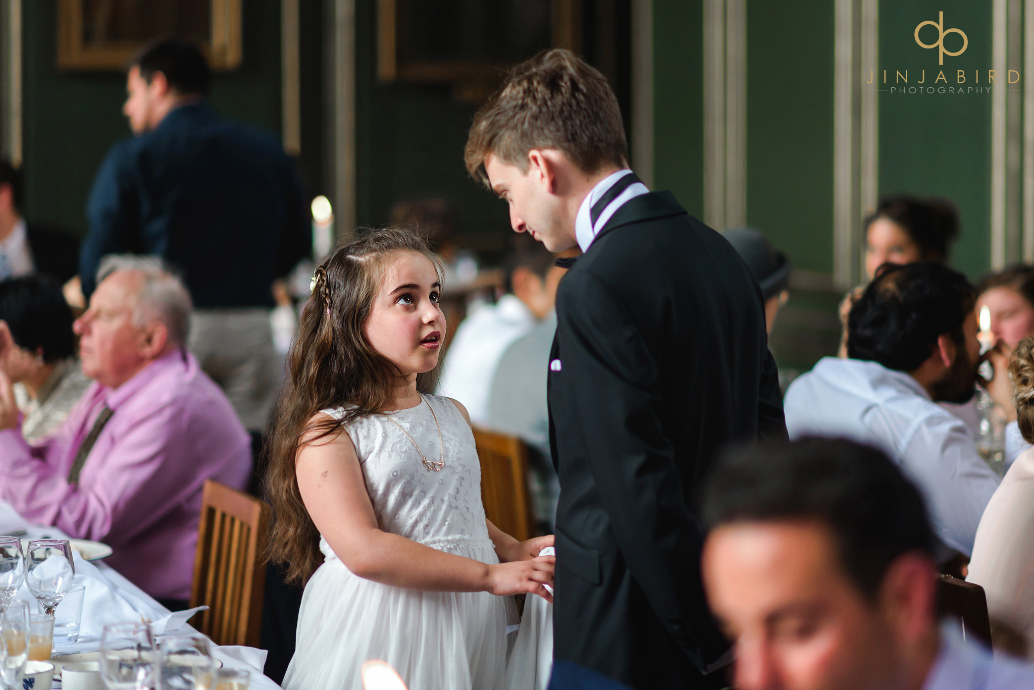 groom talking to small child