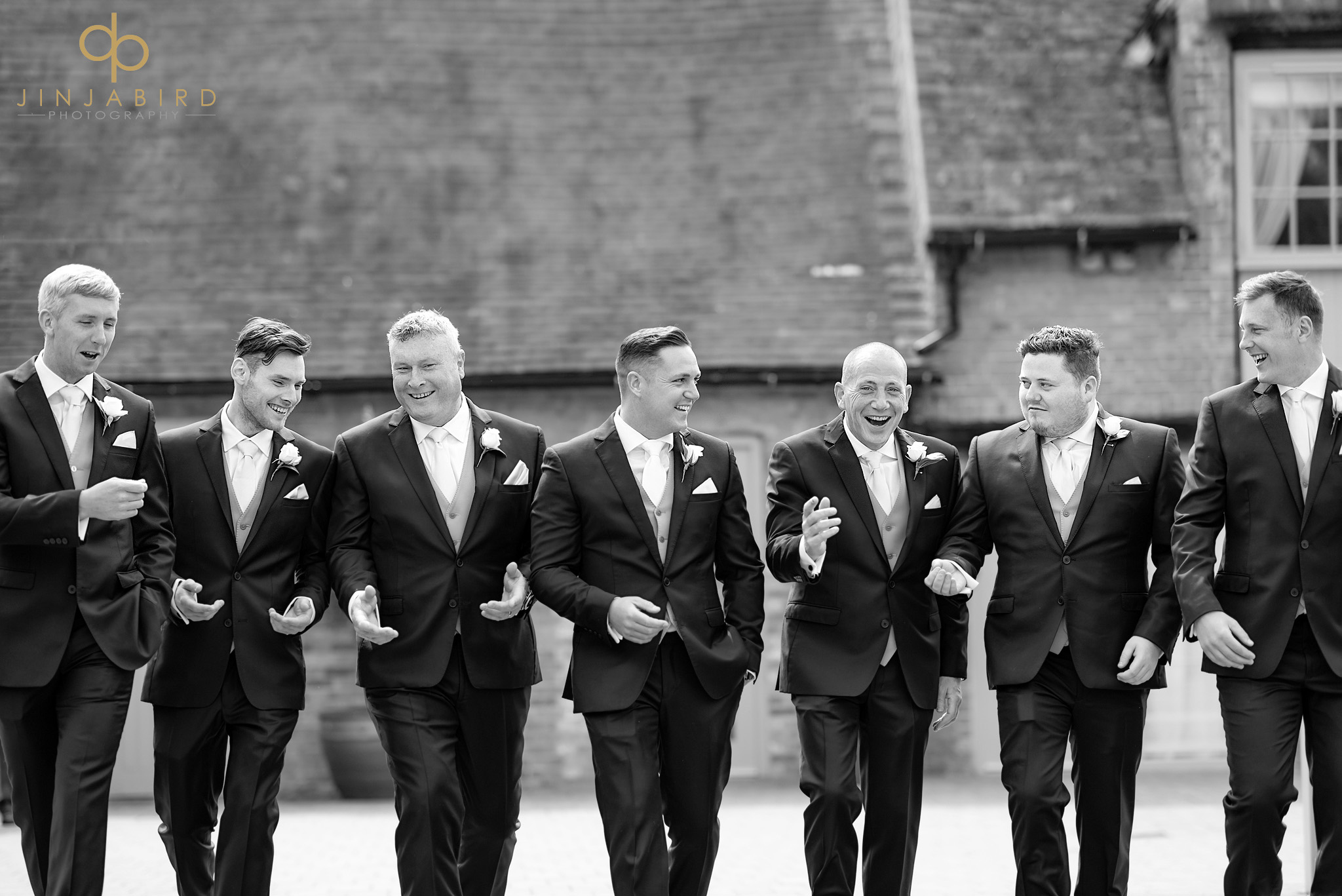 groom walking with ushers