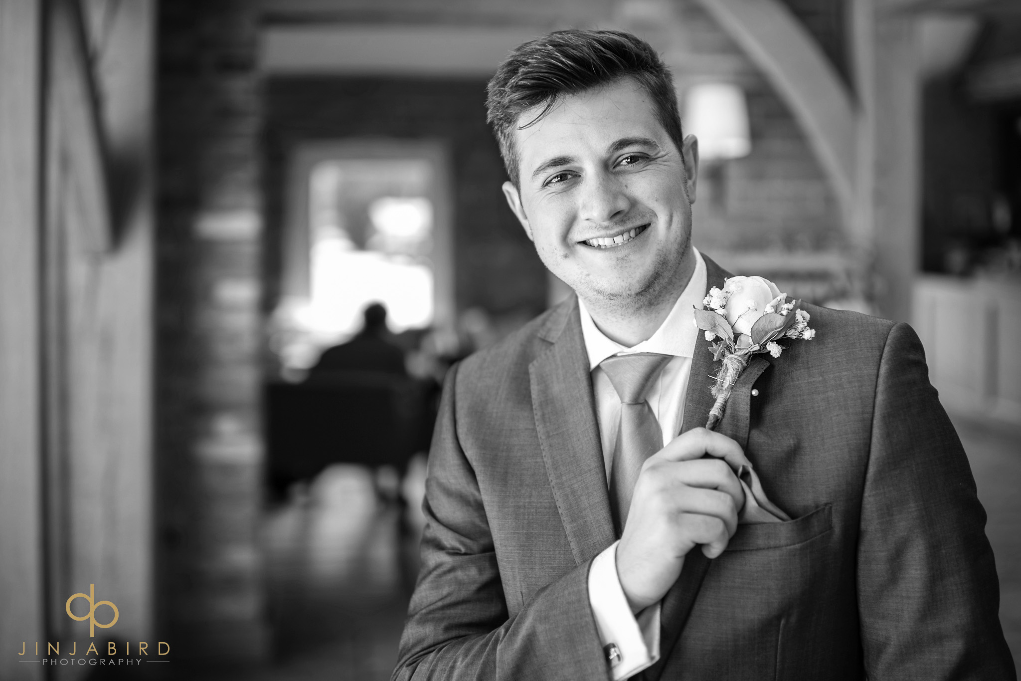 groom with buttonhole bassmead manor