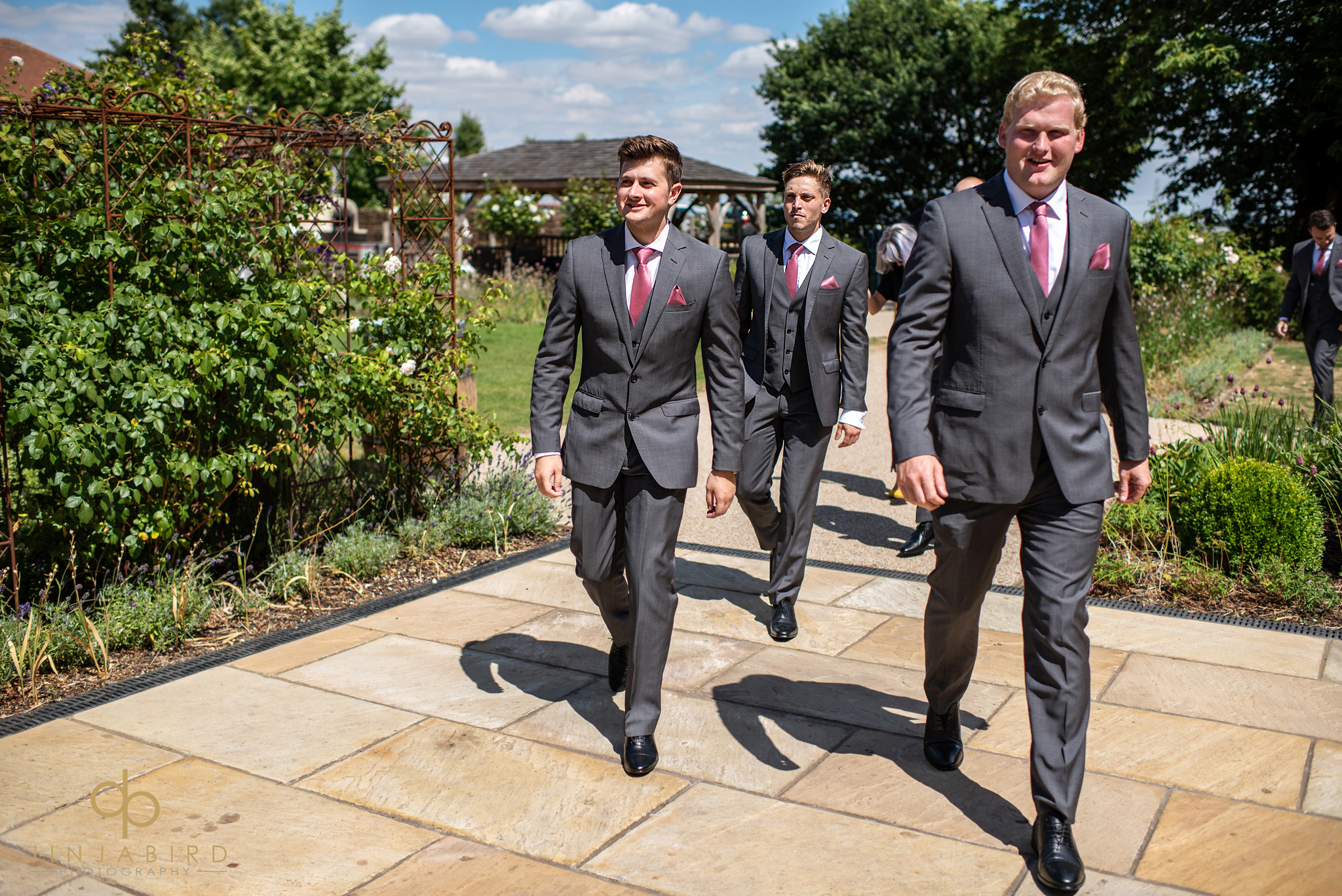 groomsmen walking bassmead manor