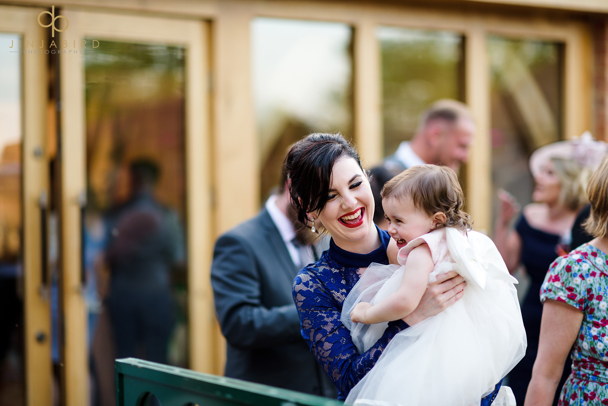 guest holding baby at wedding