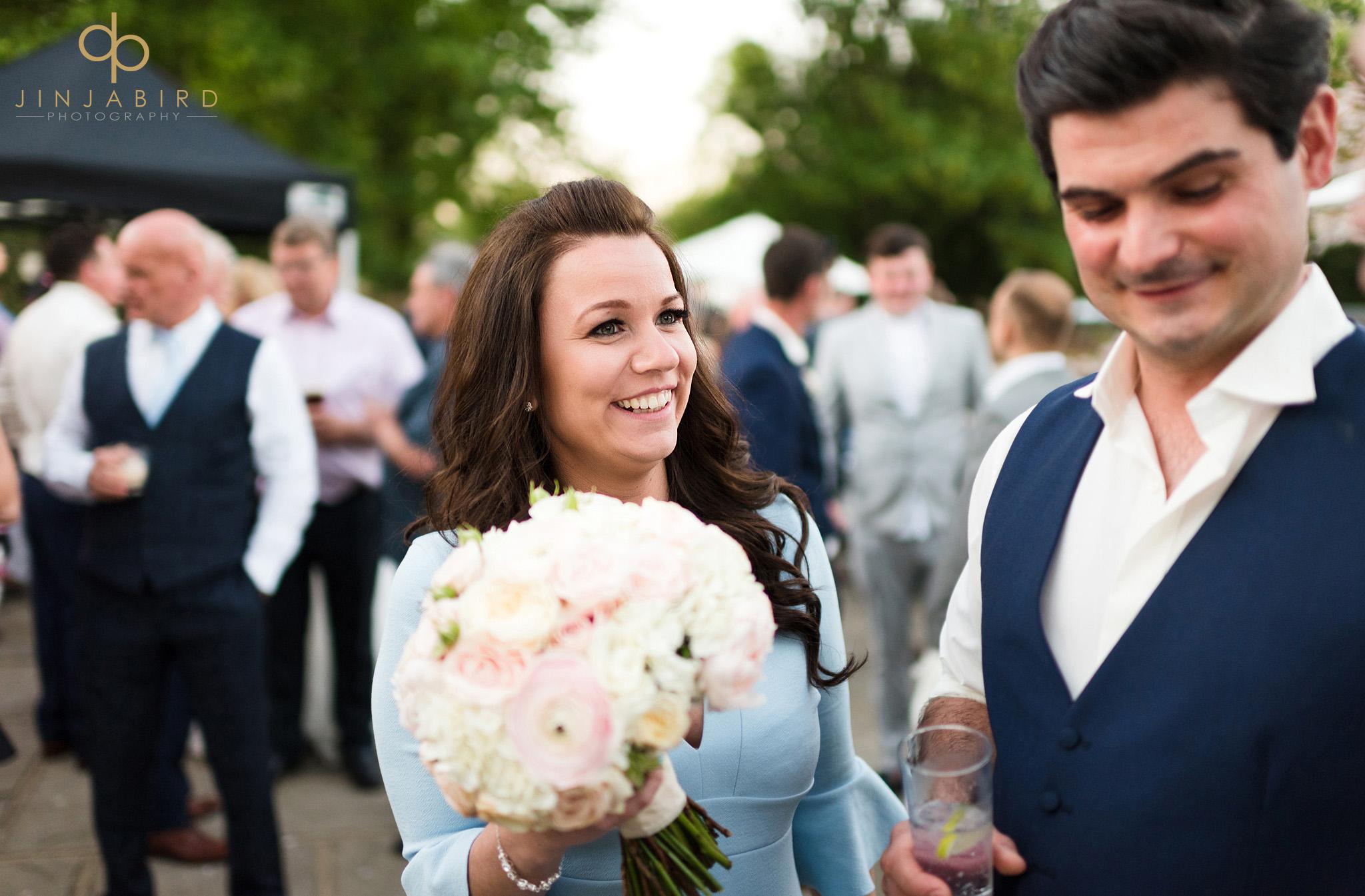 guest holding brides bouquet