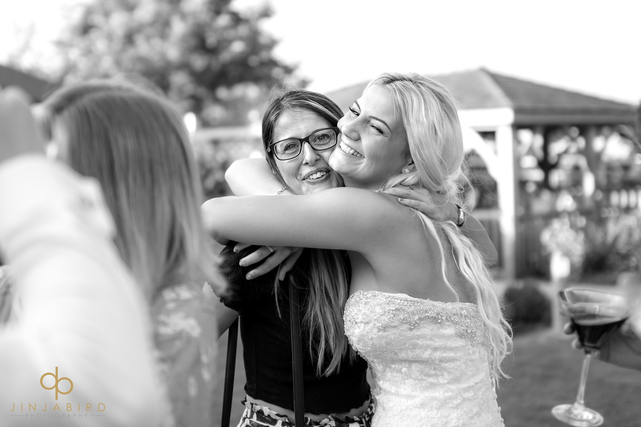 hugging the bride