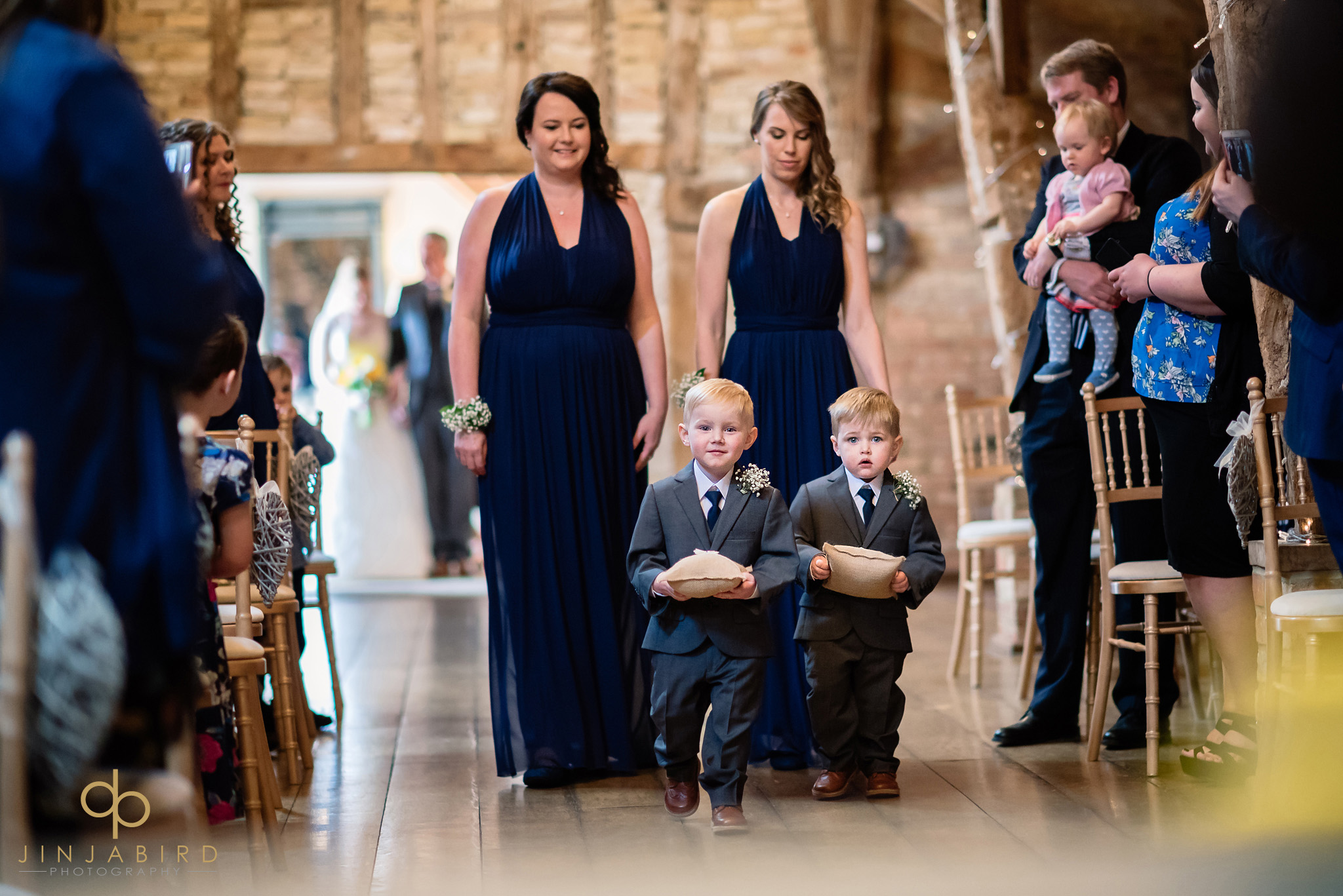 ring-bearers coming down aisle rickety barn bassmead