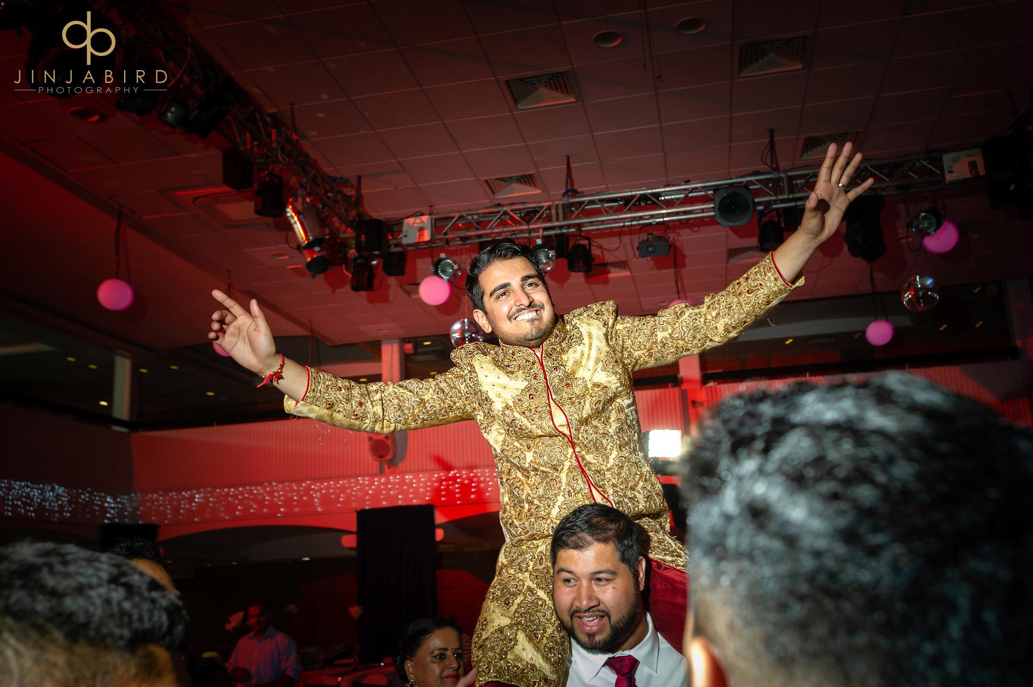 sikh groom on shoulders