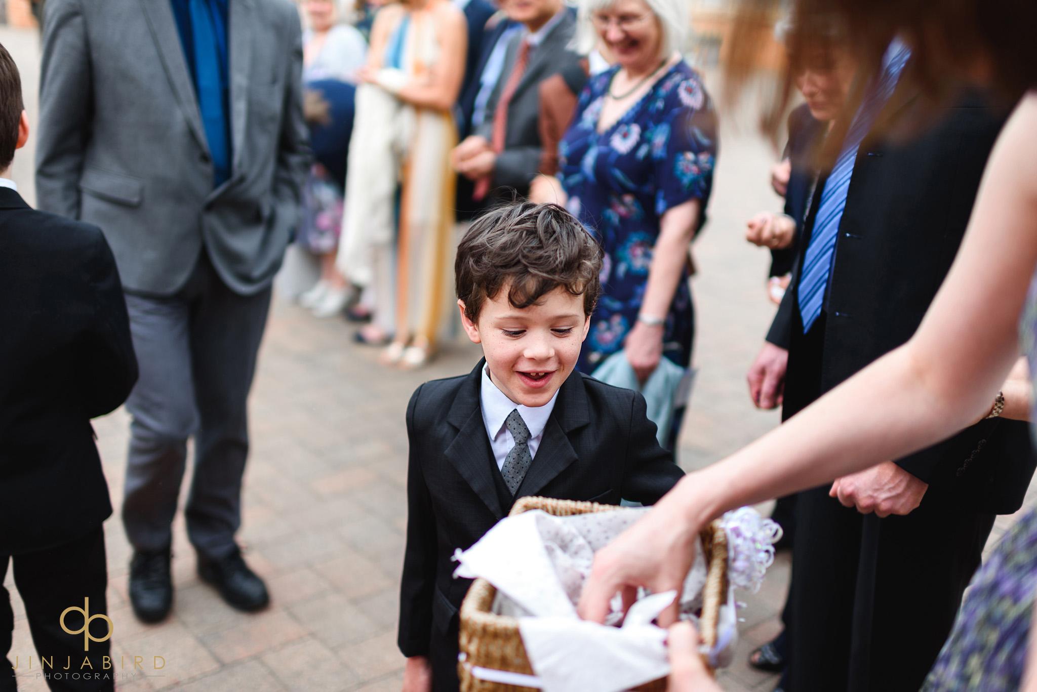 small child with wedding confetti