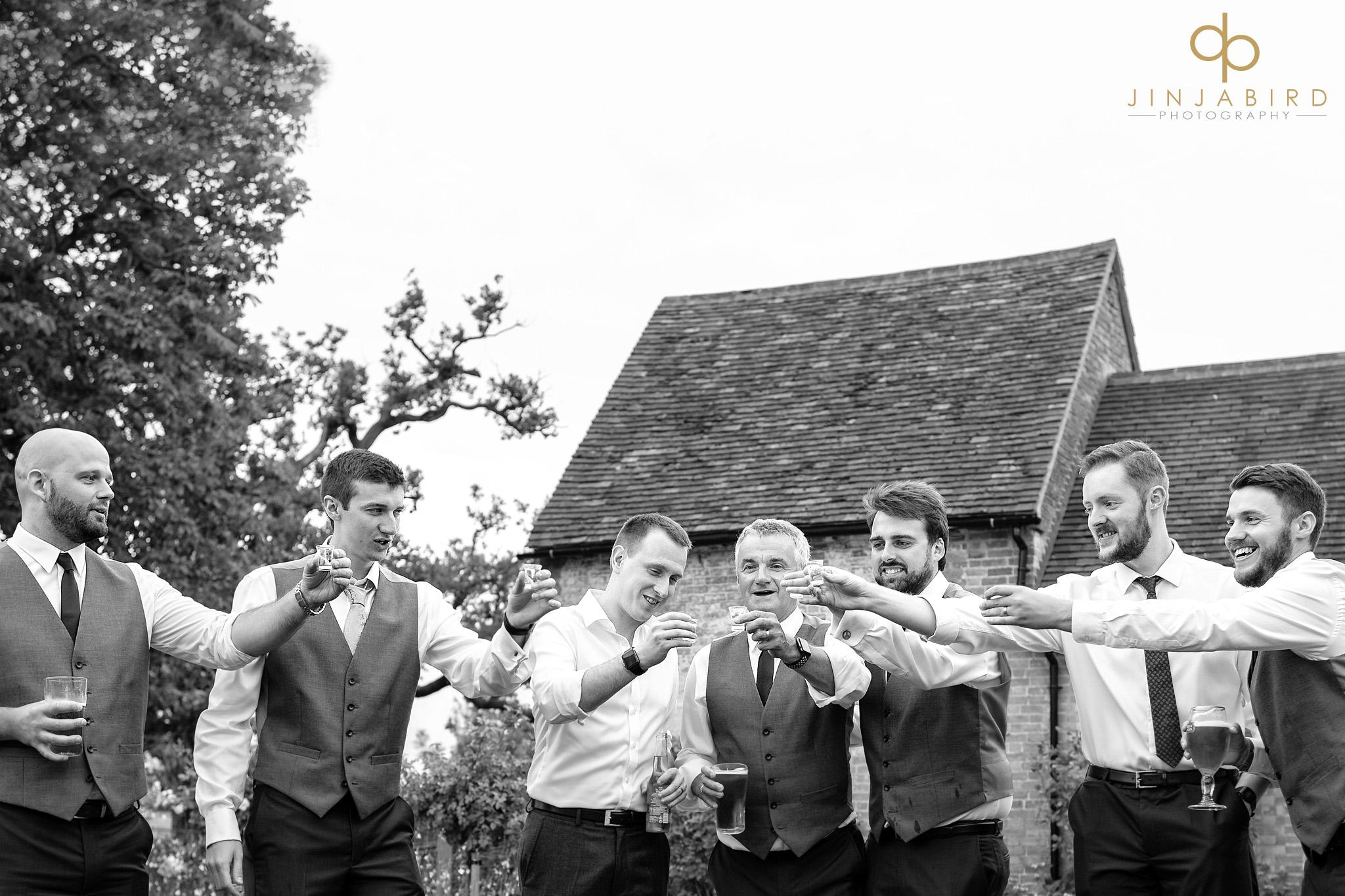 ushers drinking wedding toast