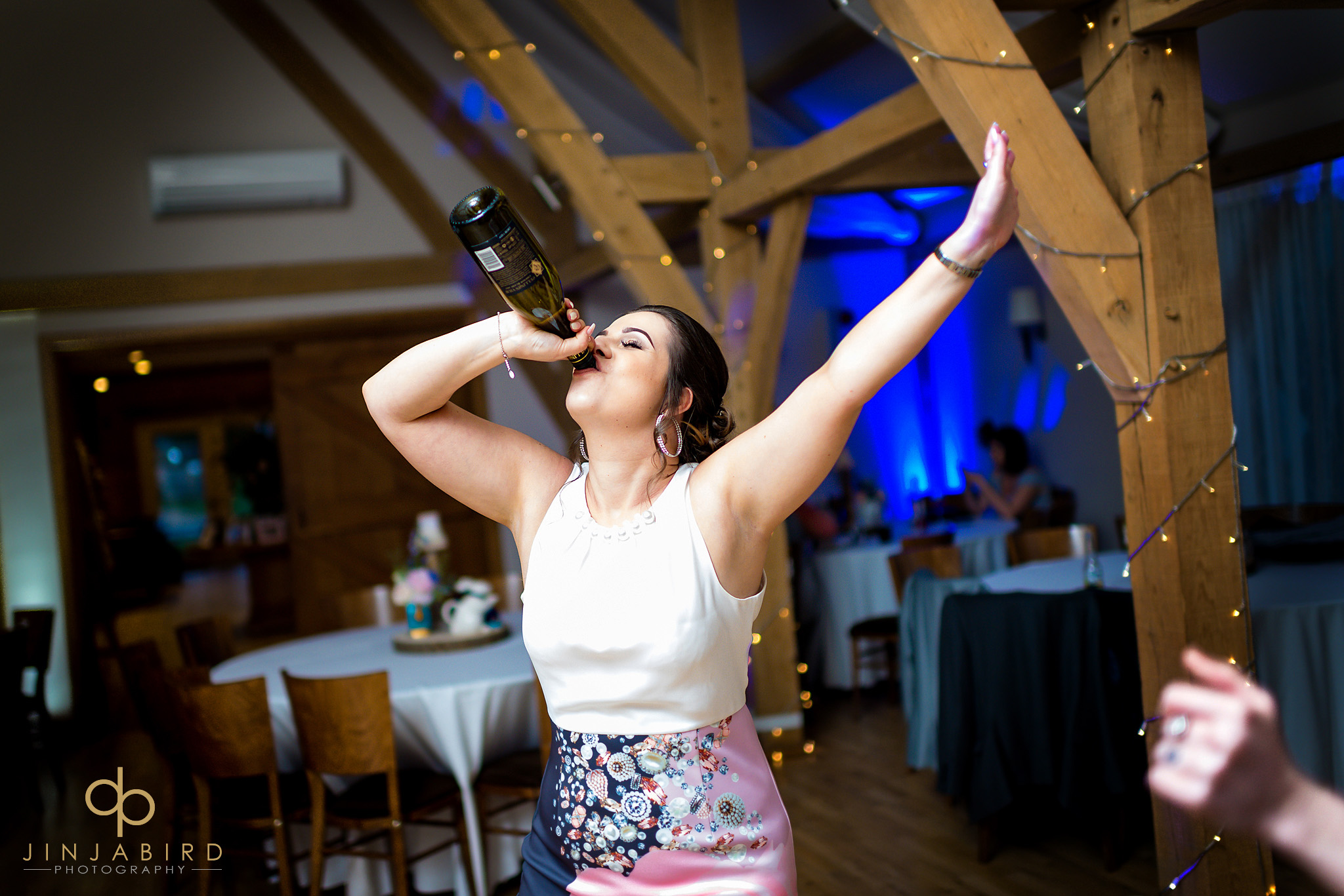 wedding guest drinking from bottle