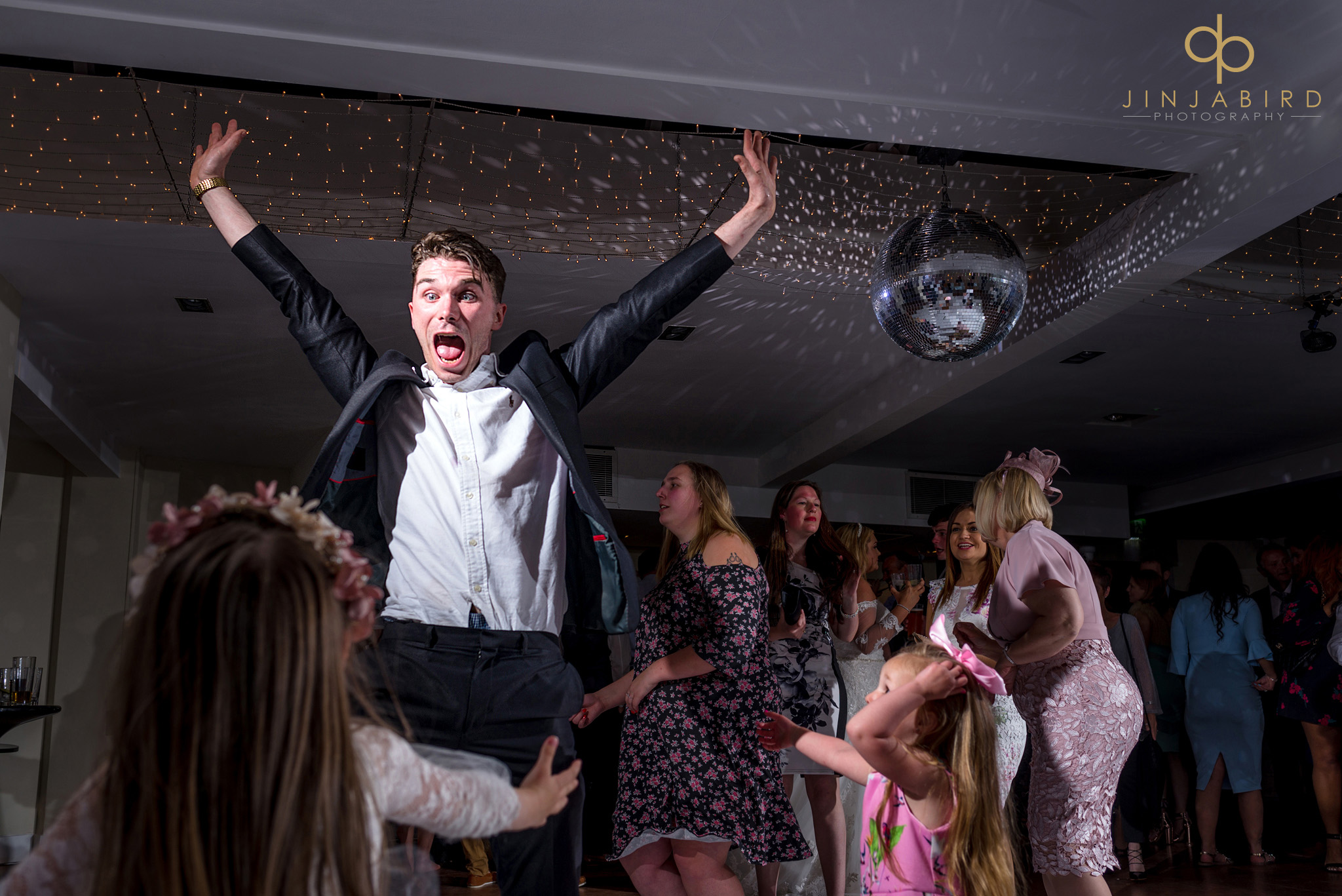 wedding guest with arms in air