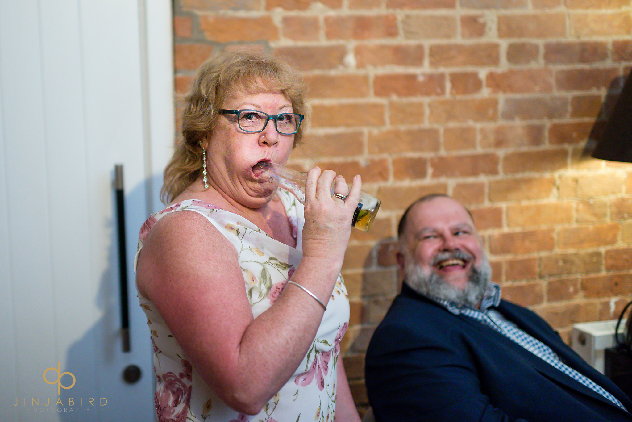 wedding guest with bottle in mouth