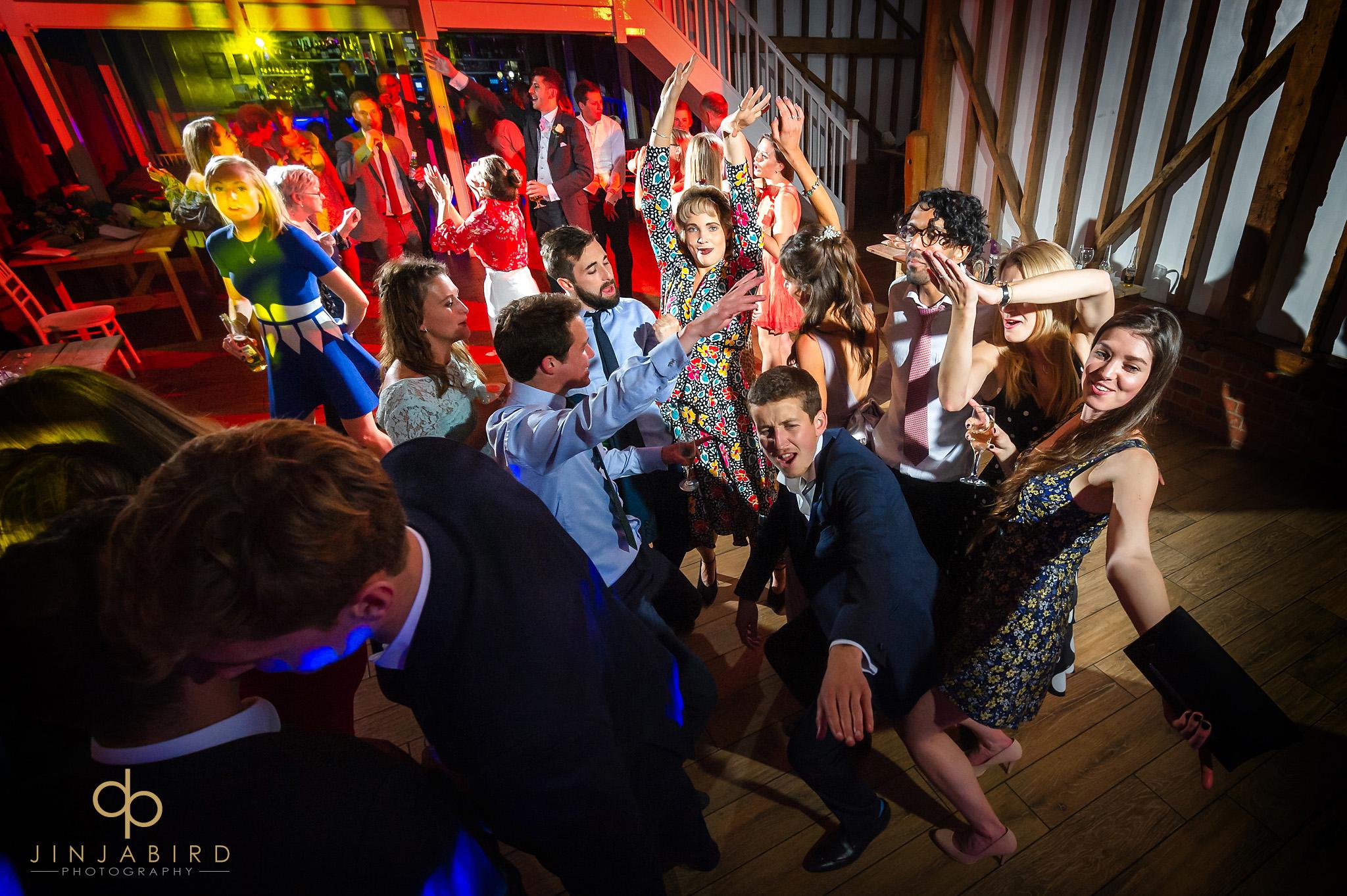 wedding guests dancing milling barn