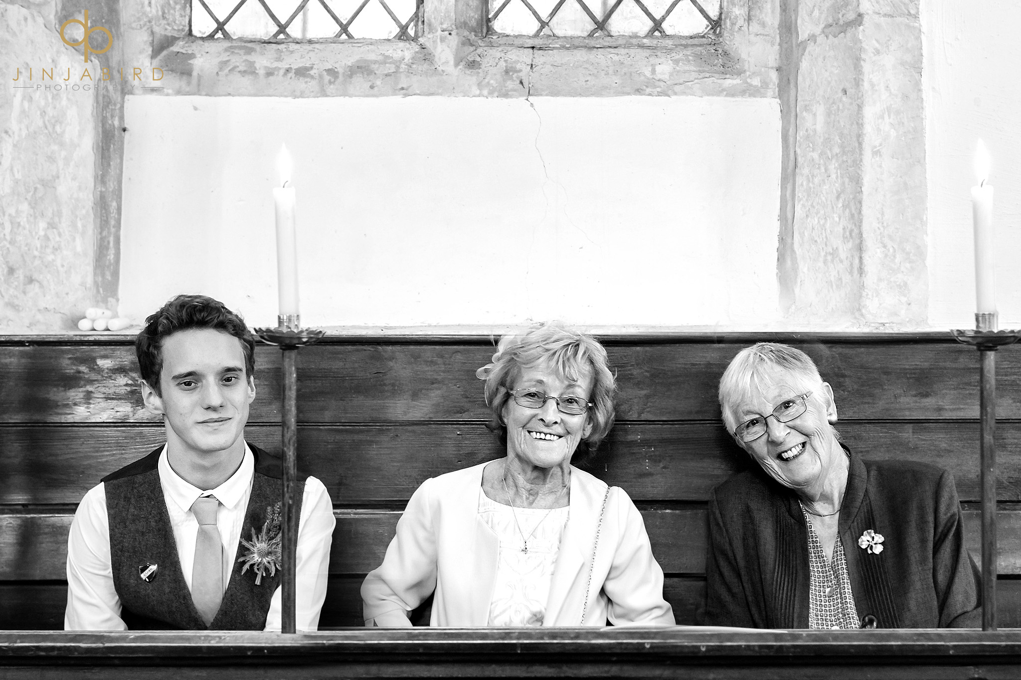 wedding guests in pew
