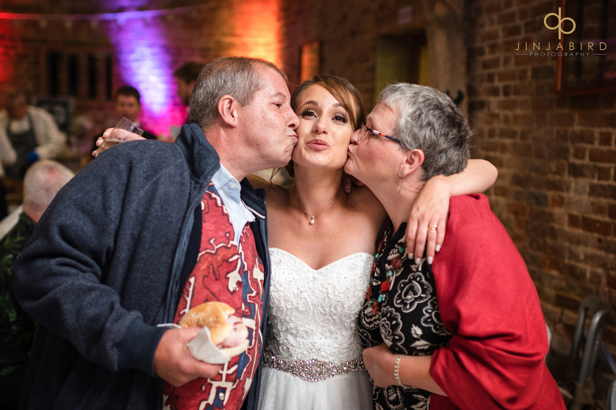 wedding guests kissing bride on cheeks
