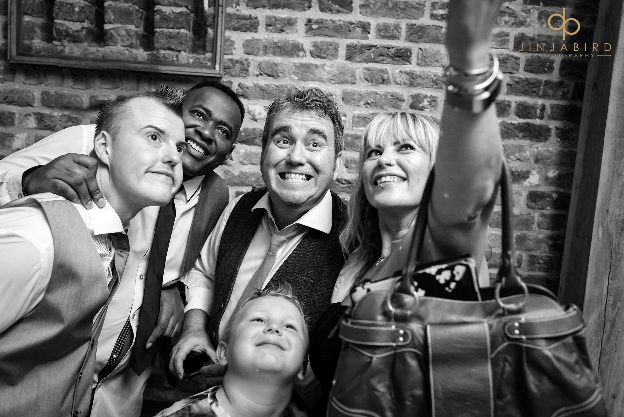 wedding guests taking selfie